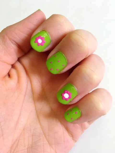 Looking for some cute nail inspiration for Spring? Check out my easy Cute Spring Flower Nails Tutorial that features bright spring colors, adorable flowers, and polka dots!#nails #springnails #flowernails