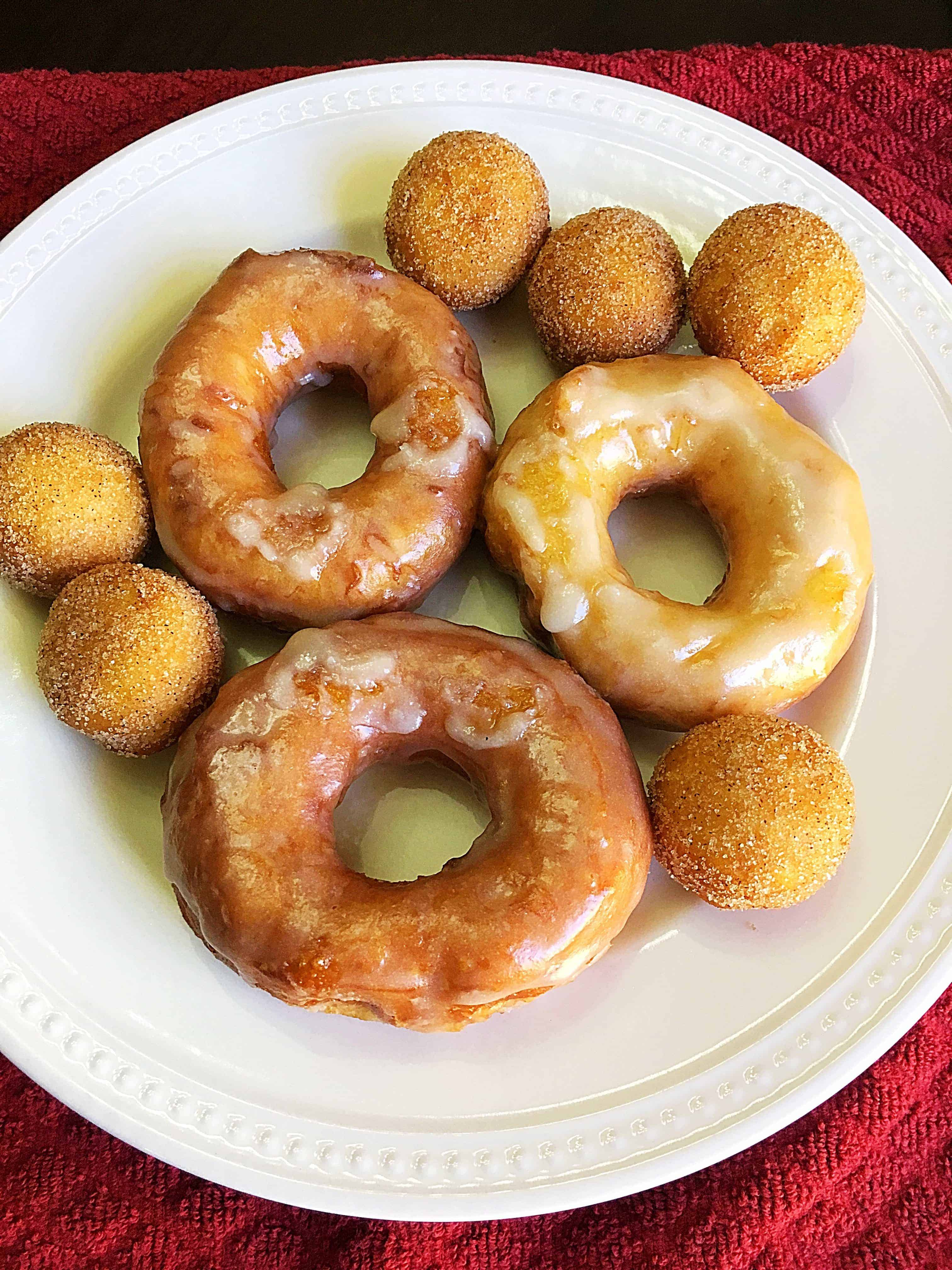 Mouthwatering Canned Biscuit Donuts- These easy-to-make glazed doughnuts are made from canned biscuits and are absolutely mouthwatering! Trust me, you won't be able to eat just one of these yummy canned biscuit donuts and they only take just a few minutes to make! #cannedbiscuitdonuts #biscuitdonuts #donuts #breakfast