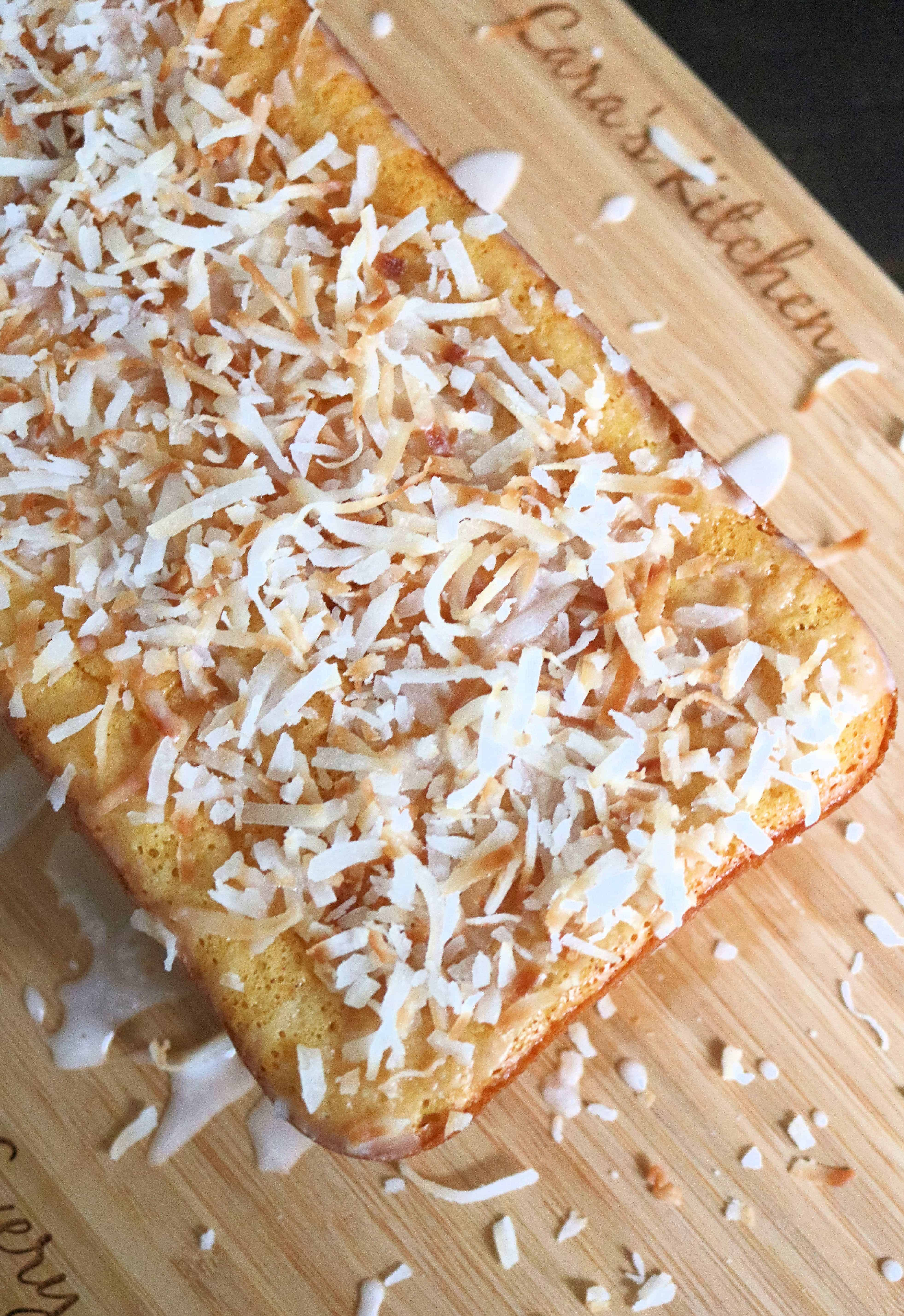 This easy coconut pineapple bread is sweet, moist, and so delicious! This pineapple bread is made with a boxed cake mix, crushed pineapple, coconut, and features a delicious sweet icing on top! #pineapplebread #bread #quickbread #baking