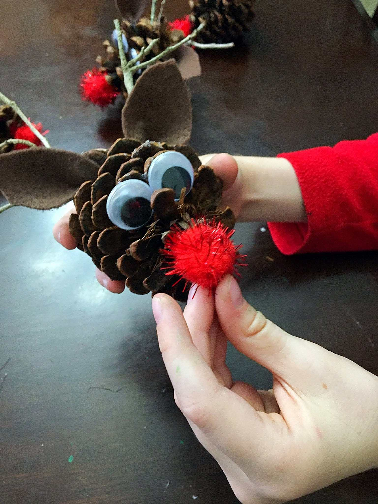 Check out these 3 Easy DIY Pinecone Christmas Ornaments for Kids, including pinecone Christmas trees, owl pinecones, and reindeer pinecone ornaments. #christmasornaments #pineconeornaments #diy #kidscrafts