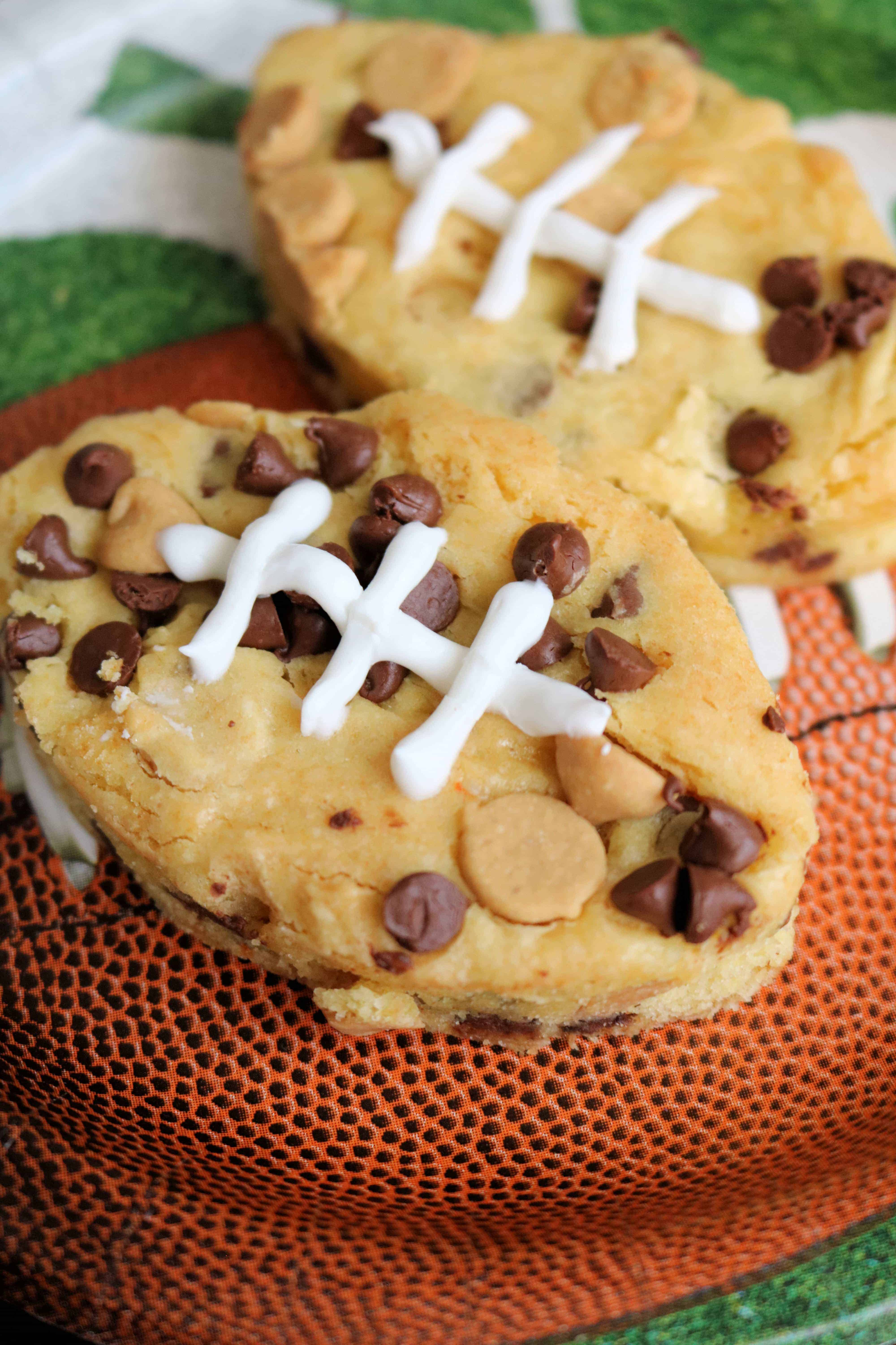 Try these Easy Football Chocolate Chip Peanut Butter Blondies for your next tailgating party! These are the BEST peanut butter blondies and guests will love the cute football shape! #blondies #peanutbutterblondies #footballdesserts #tailgating