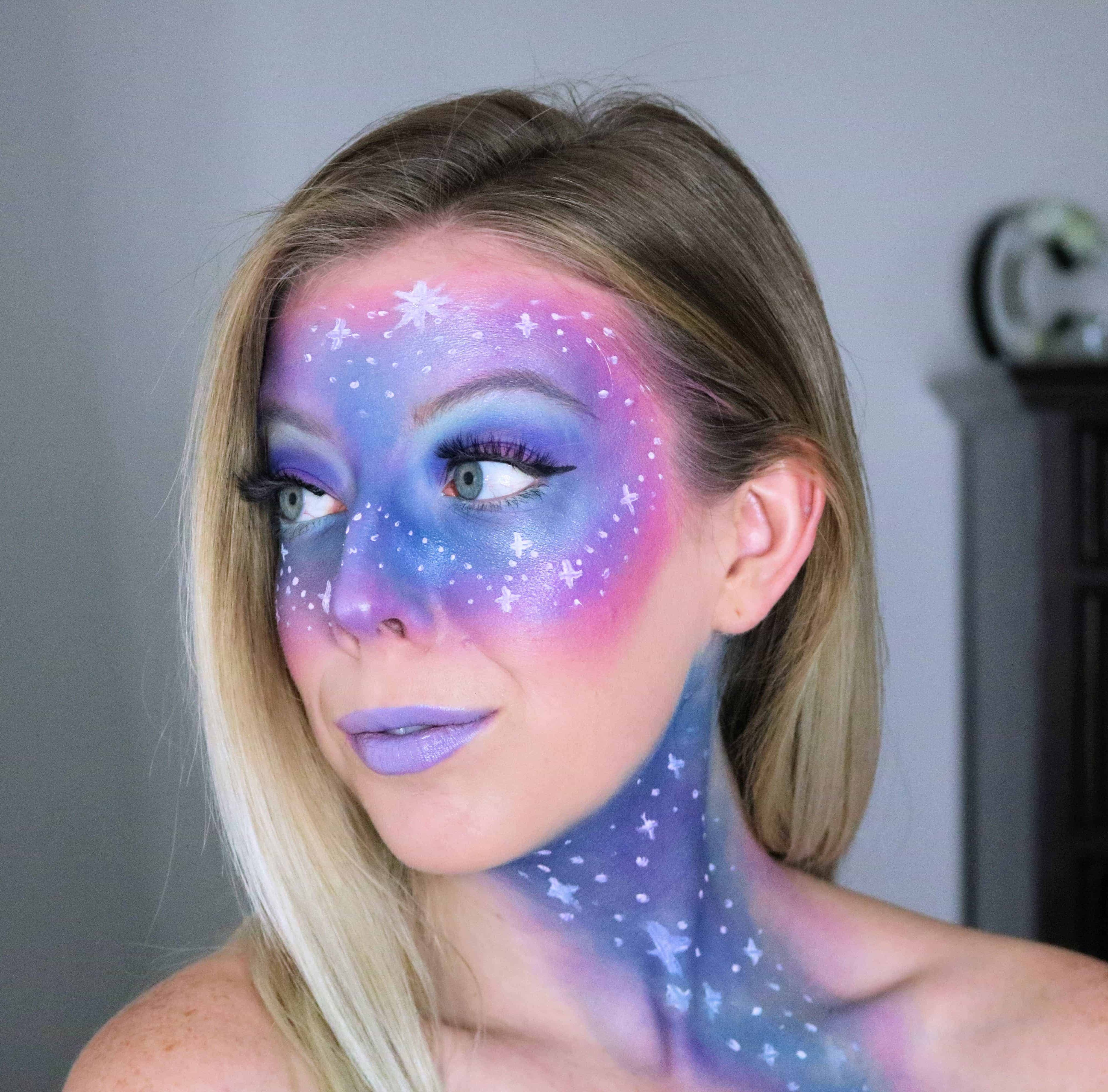 Ready to rock out your inner galaxy space princess for Halloween? Then check out my step-by-step, easy galaxy makeup tutorial with pink, purple, and blue colors and stars! This futuristic, alien, outer space look is so cute and the perfect fun Halloween costume! #galaxymakeup #halloweenmakeup #halloween #makeuptutorial