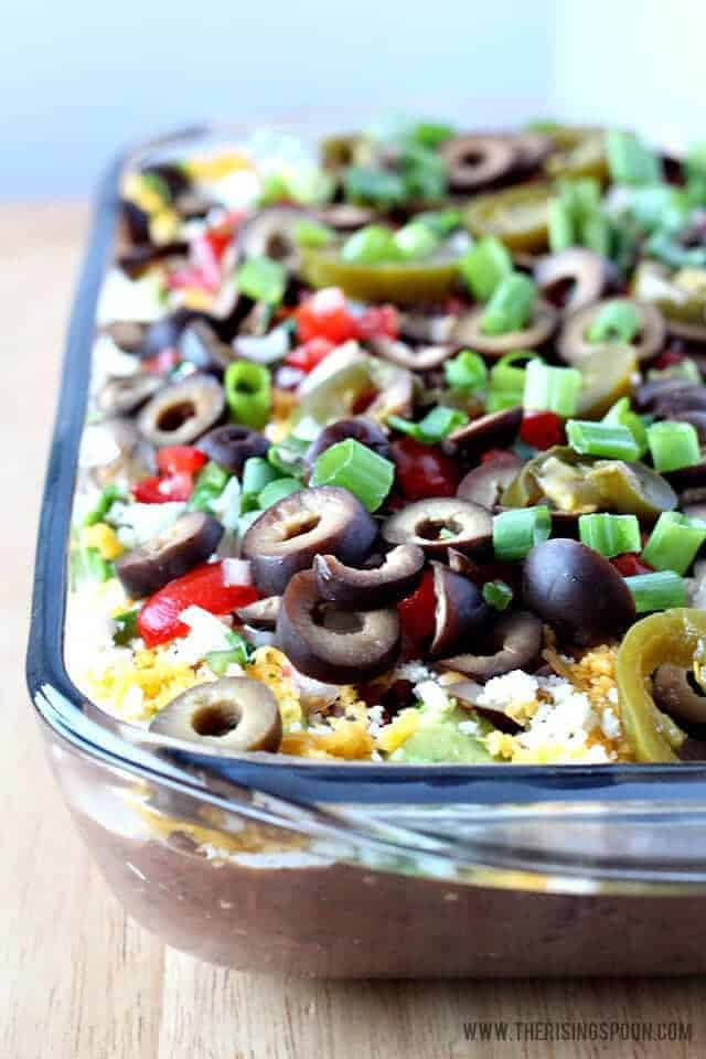 Easy 7 Layer Black Bean Dip |Need game day recipes for your Super Bowl party? Check out 65 of the best Super Bowl recipes that will feed a crowd including easy and delicious super bowl appetizers, wings, dips, sliders, snacks, desserts, and more! #superbowl #partyfood #superbowlfood #gamedayrecipes #appetizers #snacks