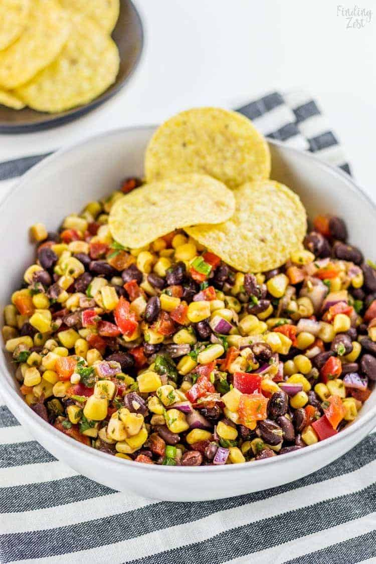 Black Bean Corn Salsa | Need game day recipes for your Super Bowl party? Check out 65 of the best Super Bowl recipes that will feed a crowd including easy and delicious super bowl appetizers, wings, dips, sliders, snacks, desserts, and more! #superbowl #partyfood #superbowlfood #gamedayrecipes #appetizers #snacks