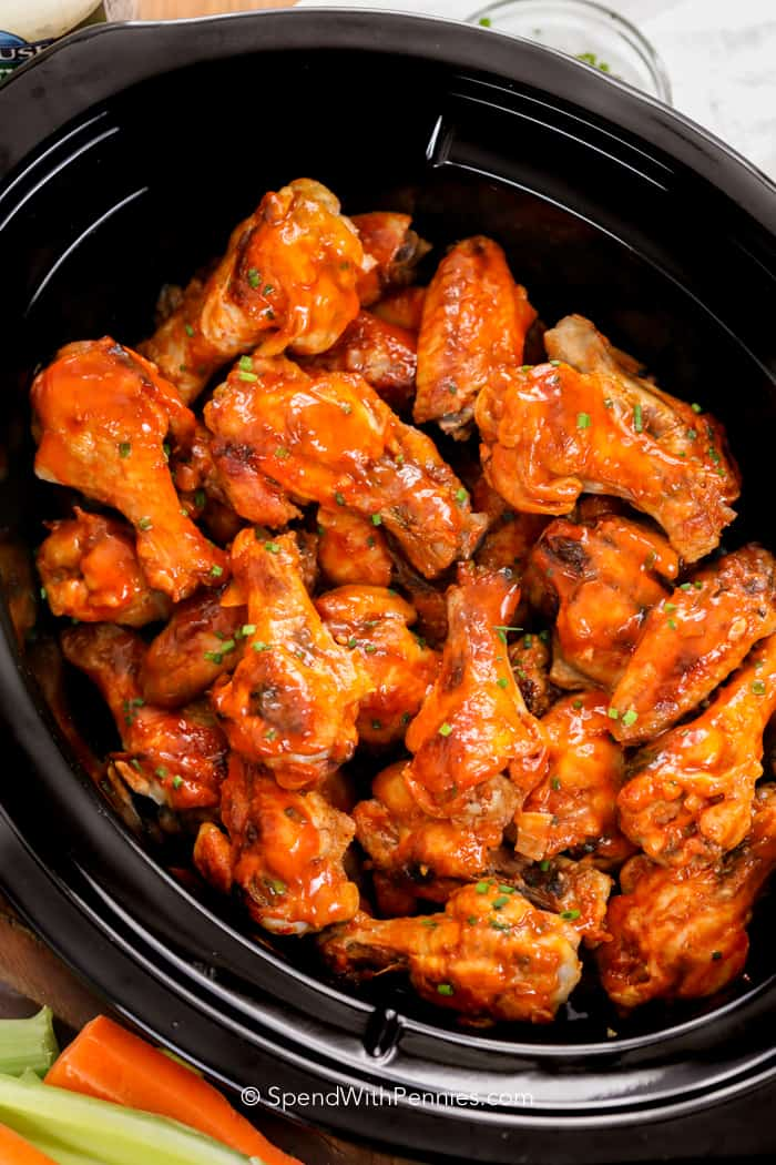 Easy Crockpot Chicken Wings | Need game day recipes for your Super Bowl party? Check out 65 of the best Super Bowl recipes that will feed a crowd including easy and delicious super bowl appetizers, wings, dips, sliders, snacks, desserts, and more! #superbowl #partyfood #superbowlfood #gamedayrecipes #appetizers #snacks
