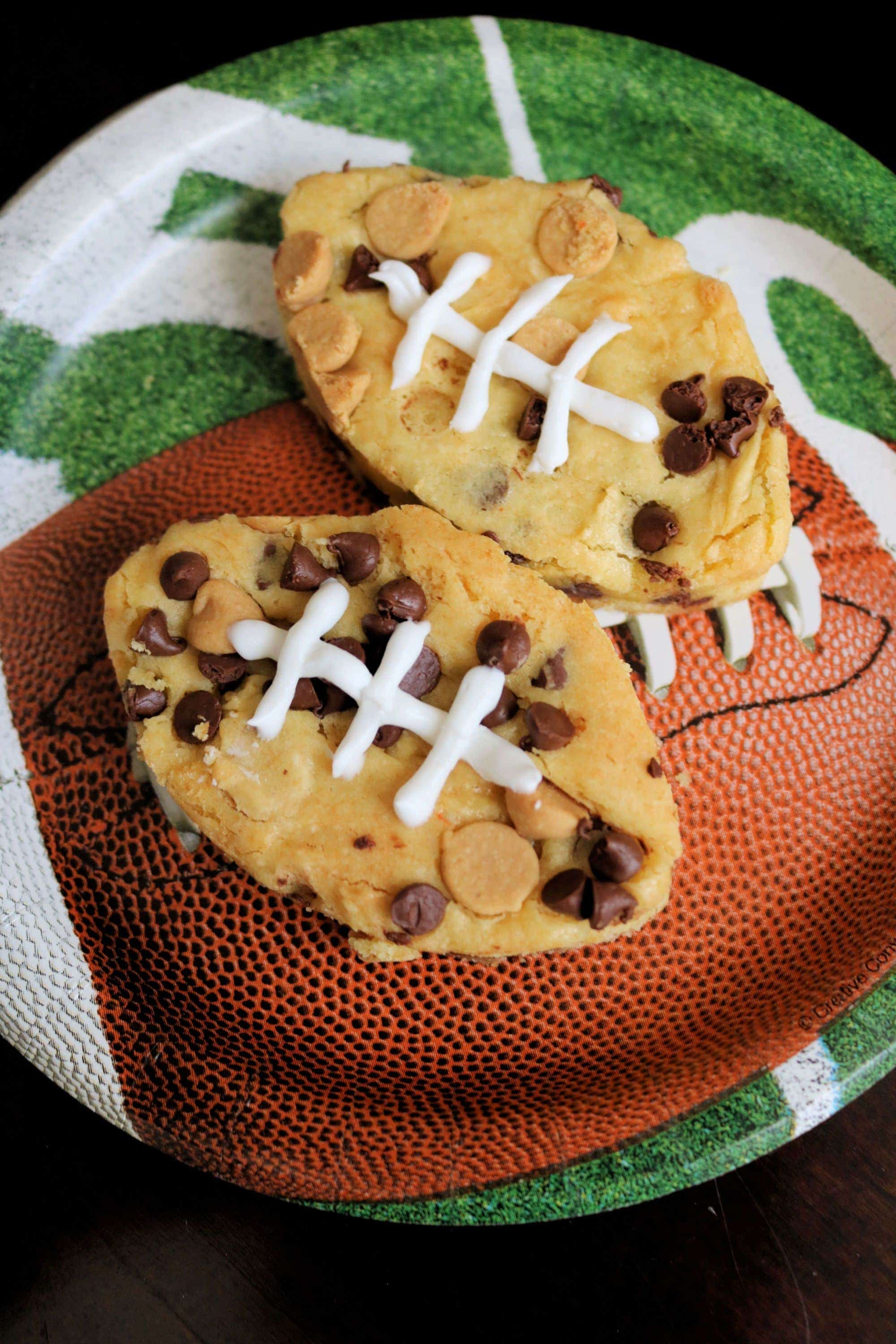 Peanut Butter Chocolate Chip Football Blondies | Need game day recipes for your Super Bowl party? Check out 65 of the best Super Bowl recipes that will feed a crowd including easy and delicious super bowl appetizers, wings, dips, sliders, snacks, desserts, and more! #superbowl #partyfood #superbowlfood #gamedayrecipes #appetizers #snacks