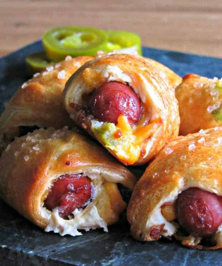 Jalapeño Popper Pigs in A Blanket | Need game day recipes for your Super Bowl party? Check out 65 of the best Super Bowl recipes that will feed a crowd including easy and delicious super bowl appetizers, wings, dips, sliders, snacks, desserts, and more! #superbowl #partyfood #superbowlfood #gamedayrecipes #appetizers #snacks