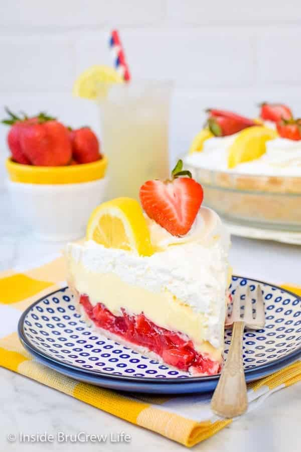 Lemon Cream Strawberry Pie - Stay cool this summer with these 30 Delicious and Easy No Bake Summer Desserts with delicious cake, cheesecake, puddings, fruit, graham crackers, cream pies, chocolate, and more! These cold, refreshing, no bake summer desserts are perfect for making for a crowd for a party, and all your family, friends, and kids will love these yummy no bake desserts! #nobake #desserts #summerdesserts