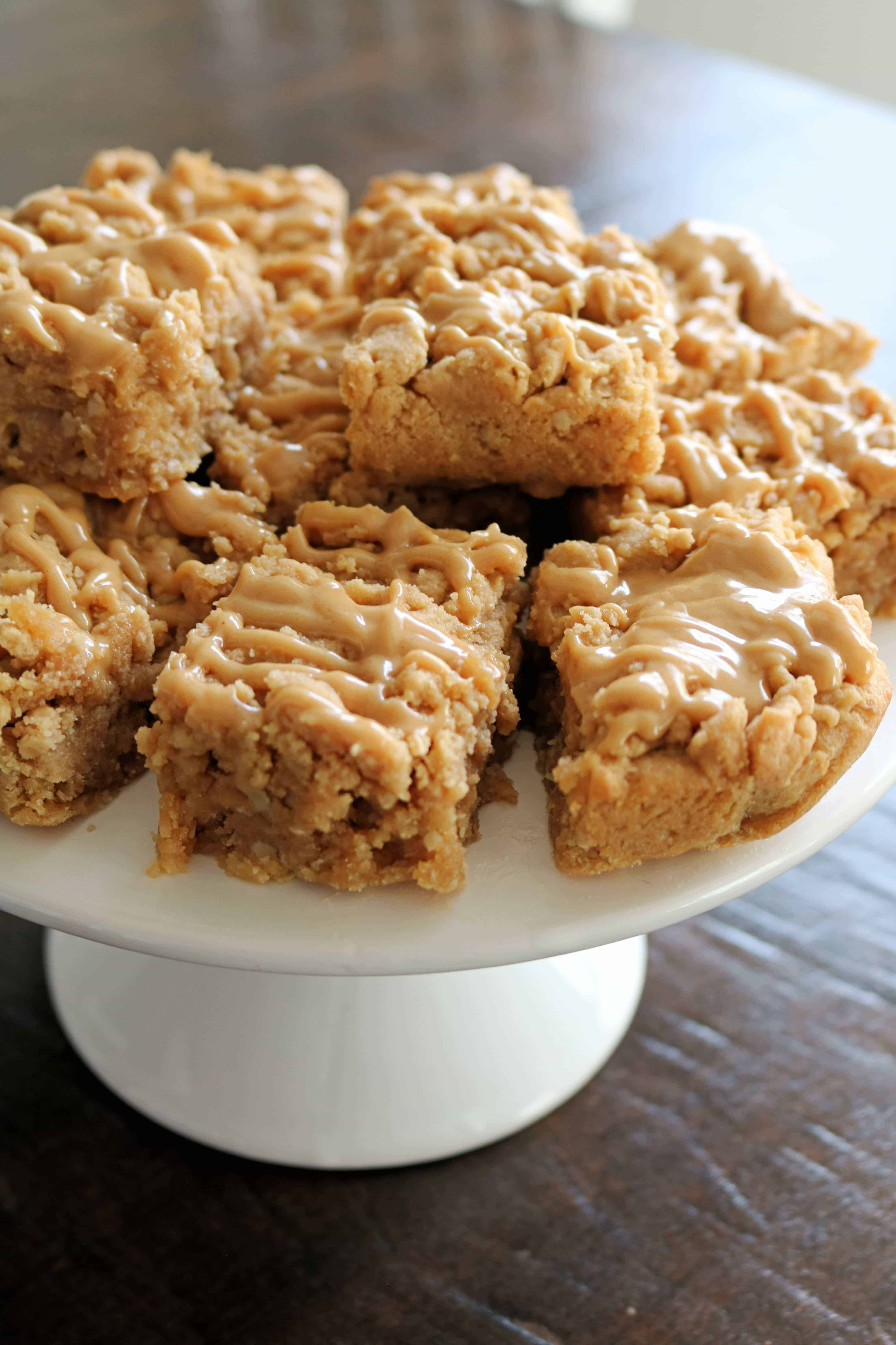 #ad These Triple Peanut Butter Oatmeal Bars are thick, soft, delicious, and full of an irresistible peanut butter flavor you can't resist! Even better these peanut butter bars use only simple ingredients and bake in less than 30 minutes! #HowDoYouPB #dessert #peanutbutterbars