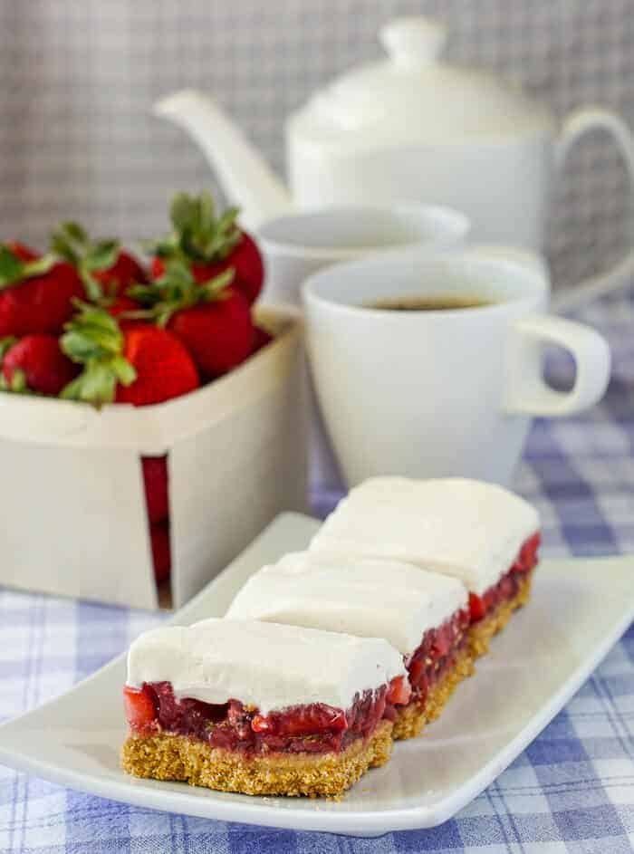 Strawberry Pie Bars - Stay cool this summer with these 30 Delicious and Easy No Bake Summer Desserts with delicious cake, cheesecake, puddings, fruit, graham crackers, cream pies, chocolate, and more! These cold, refreshing, no bake summer desserts are perfect for making for a crowd for a party, and all your family, friends, and kids will love these yummy no bake desserts! #nobake #desserts #summerdesserts