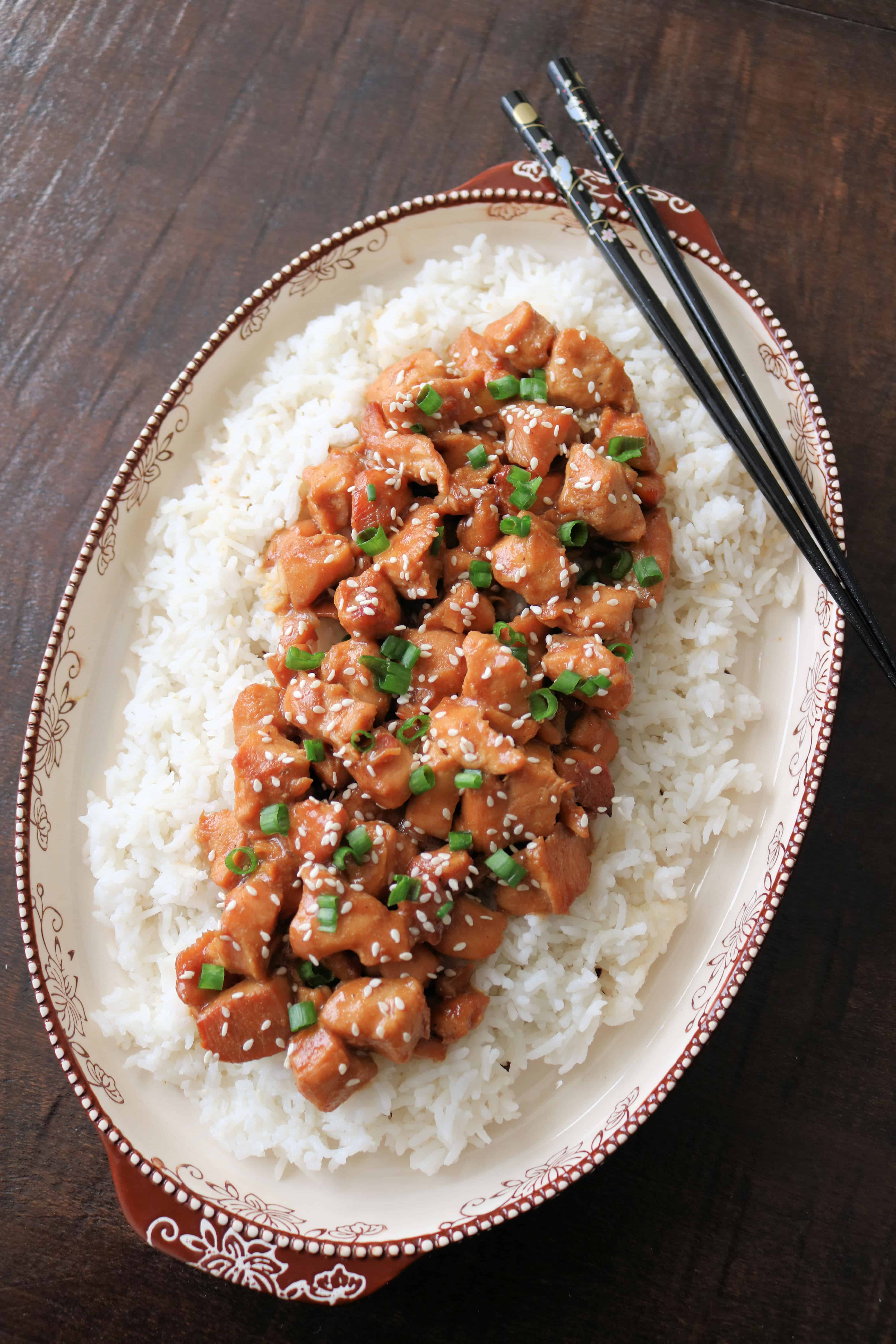 Try my delicious and easy slow cooker honey sesame chicken that's healthier than Asian take-out and made in the crockpot with diced boneless skinless chicken breast and a simple honey soy sauce. Serve with veggies and rice or noodles for an easy weeknight dinner the whole family will love. Freezer-friendly and great for healthy meal prep! #chicken #chinesefood #dinner