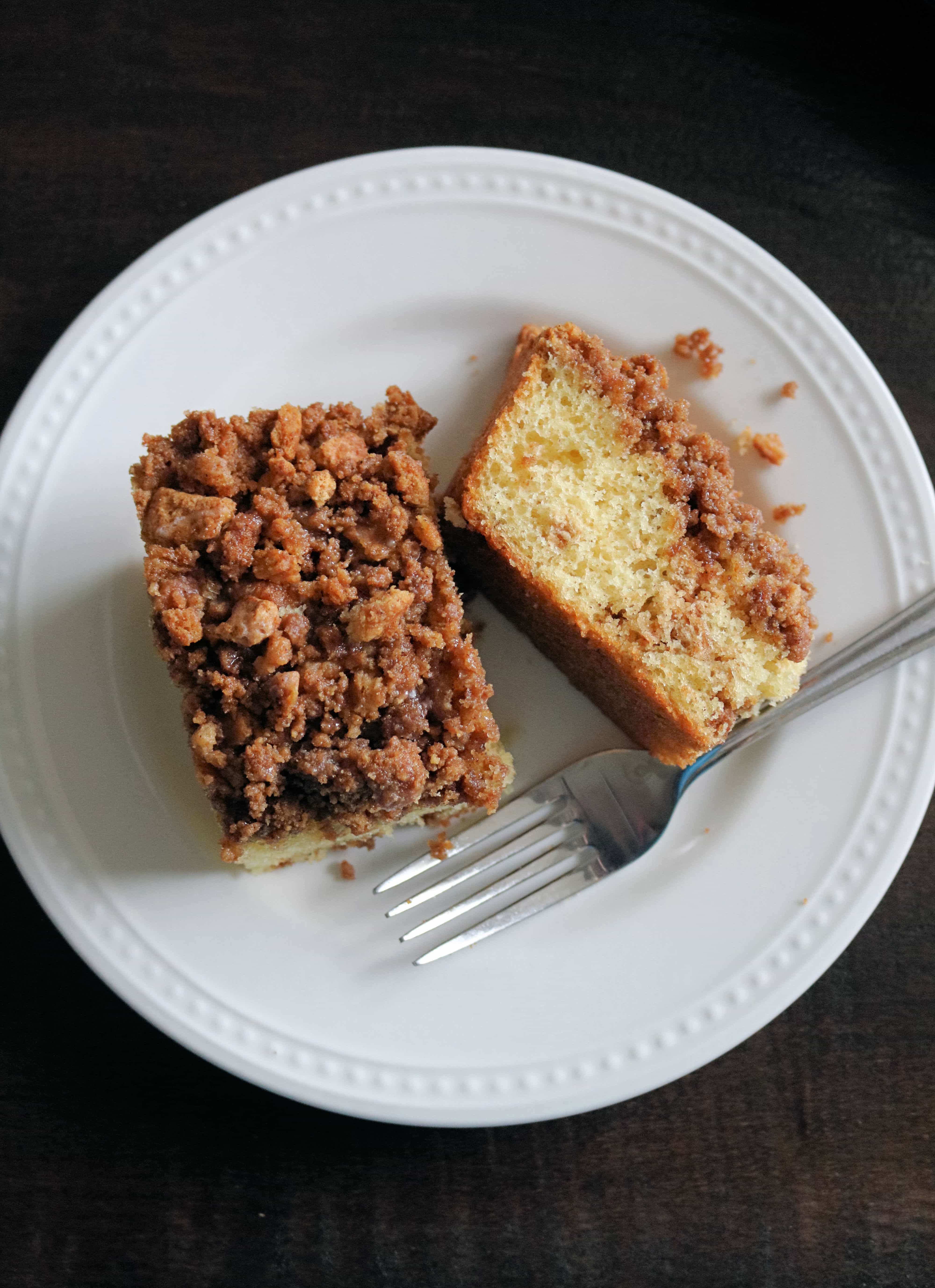This delicious graham cracker coffee cake recipe starts with a simple yellow cake mix and features a delicious cinnamon sugar and graham cracker streusel that is layered both in the cake and on top. #coffeecake #breakfastrecipe #cakerecipe #streusel
