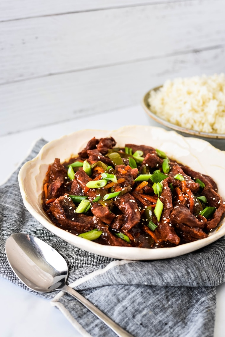 Slow Cooker Mongolian Beef - Need easy weeknight meal ideas? Check out this incredible roundup of 25 Easy Slow Cooker Recipes full of delicious slow cooked meals that you can throw in the crockpot and enjoy! #slowcooker #crockpot #dinnerrecipes #slowcookerrecipes