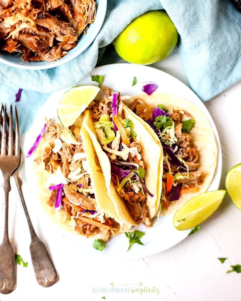 Crockpot Pulled Pork Tacos - Looking for the best slow cooker dinner recipes? Check out this incredible roundup of 25 Easy Slow Cooker Recipes full of delicious and healthy crockpot meals including chicken, beef, pork, pasta, soup, and more! Simply dump them in the crockpot and go! #slowcooker #crockpot #slowcookerrecipes #crockpotrecipes