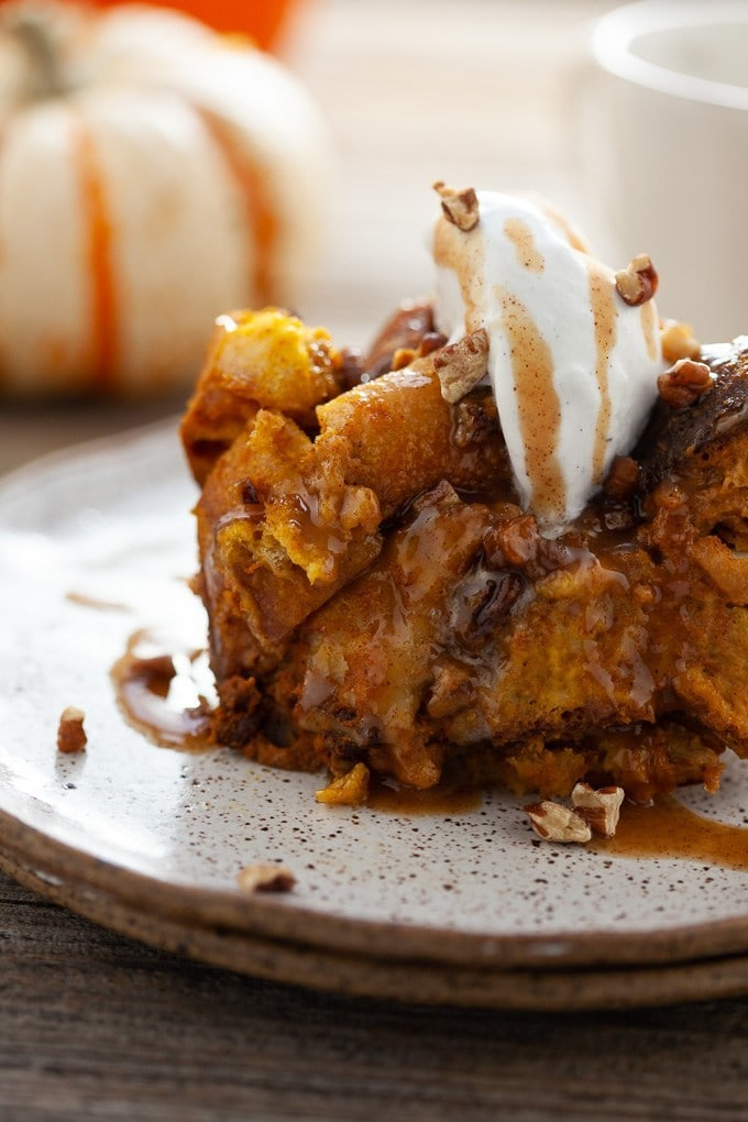 Slow Cooker Pumpkin Bread Pudding |Check out these 15 Easy Pumpkin Desserts for Fall and Thanksgiving! From quick and easy desserts with simple ingredients like pumpkin pie and pumpkin cream cheese bread, to pumpkin cookies, cheesecake, and cake, you'll love this list of the best pumpkin desserts ever!  #pumpkindesserts #pumpkinrecipes #falldesserts #thanksgiving