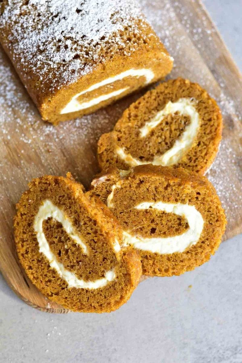 Pumpkin Roll | Here's 15 of the Best Pumpkin Desserts for Fall including pumpkin pie, pumpkin bread, pumpkin cookies and more! Head on over for all the recipes for these delicious and easy pumpkin desserts. #pumpkindesserts #pumpkinrecipes #falldesserts