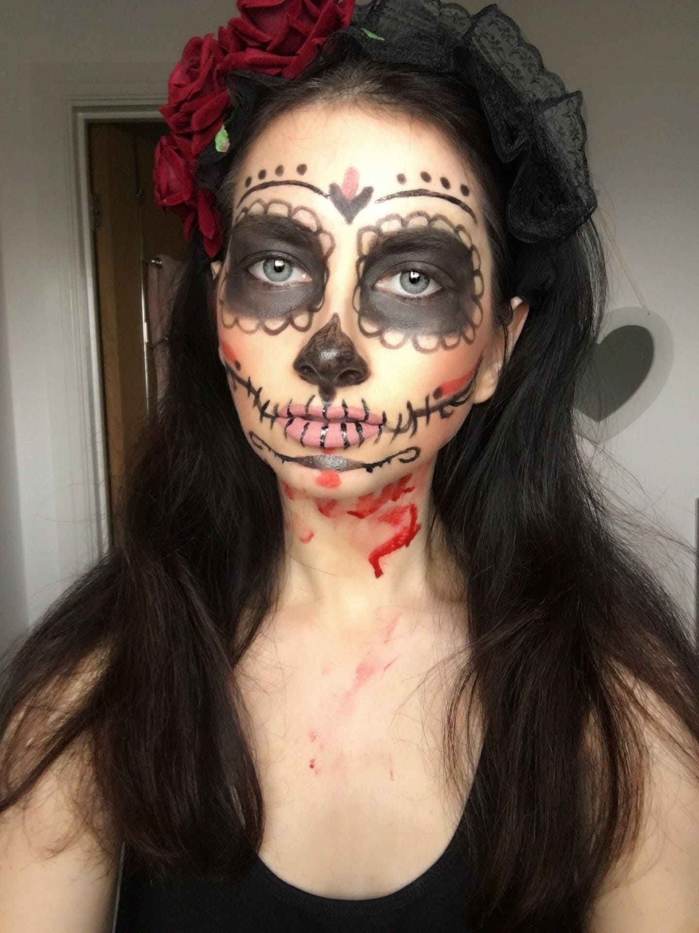 Day of the Dead Sugar Skull Halloween Makeup - Check out these 40 cute and creative Halloween costume ideas for women, couples, families, and friends! #halloween #halloweencostumes #halloweencostumeideas