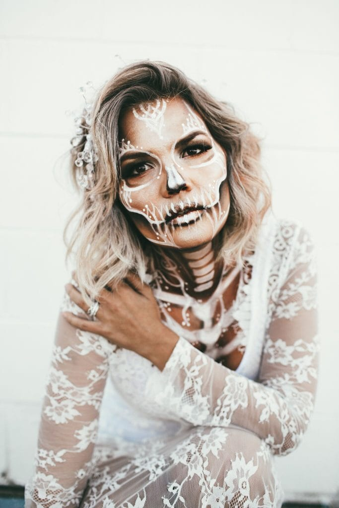 Skeleton Bride Halloween Costume - Looking for cute, cheap, and easy Halloween costumes or unique last-minute, DIY Halloween costume ideas? Check out these 40 Creative Halloween Costume Ideas for women, moms, cute couples, small and large families, and best friends! You're sure to win the best Halloween costumes with these picks. #halloween #halloweencostumes #halloweencostumeideas #easycostumes
