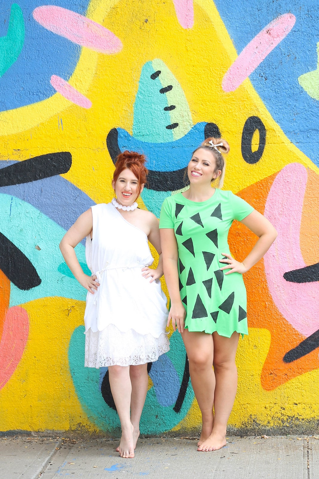 Wilma and Pebbles Flintstones Halloween Costume - Looking for cute, cheap, and easy Halloween costumes or unique last-minute, DIY Halloween costume ideas? Check out these 40 Creative Halloween Costume Ideas for women, moms, cute couples, small and large families, and best friends! You're sure to win the best Halloween costumes with these picks. #halloween #halloweencostumes #halloweencostumeideas #easycostumes