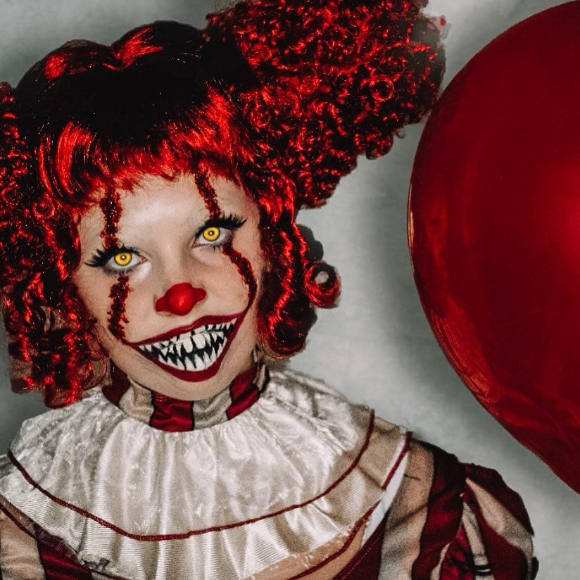 "She Pennywise from ""IT"" Halloween Costume - Check out these 40 cute and creative Halloween costume ideas for women, couples, families, and friends! #halloween #halloweencostumes #halloweencostumeideas"