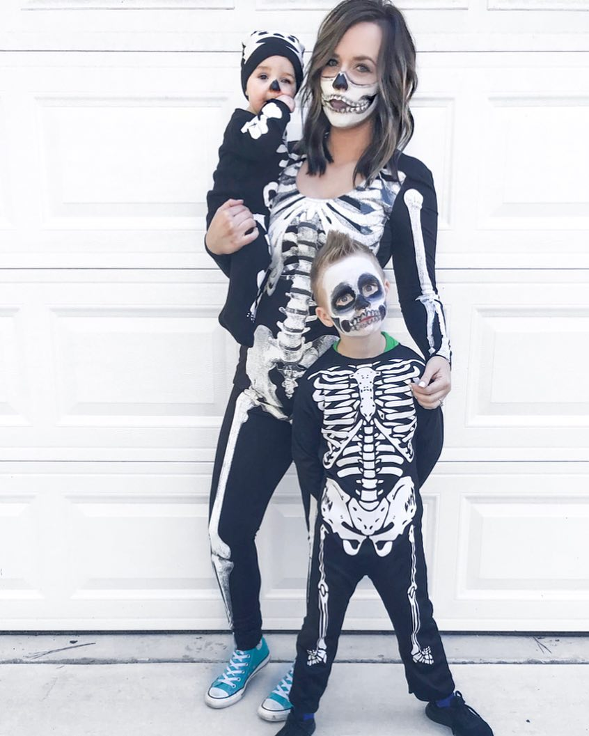 Skeleton Family Halloween Costumes - Looking for cute, cheap, and easy Halloween costumes or unique last-minute, DIY Halloween costume ideas? Check out these 40 Creative Halloween Costume Ideas for women, moms, cute couples, small and large families, and best friends! You're sure to win the best Halloween costumes with these picks. #halloween #halloweencostumes #halloweencostumeideas #easycostumes