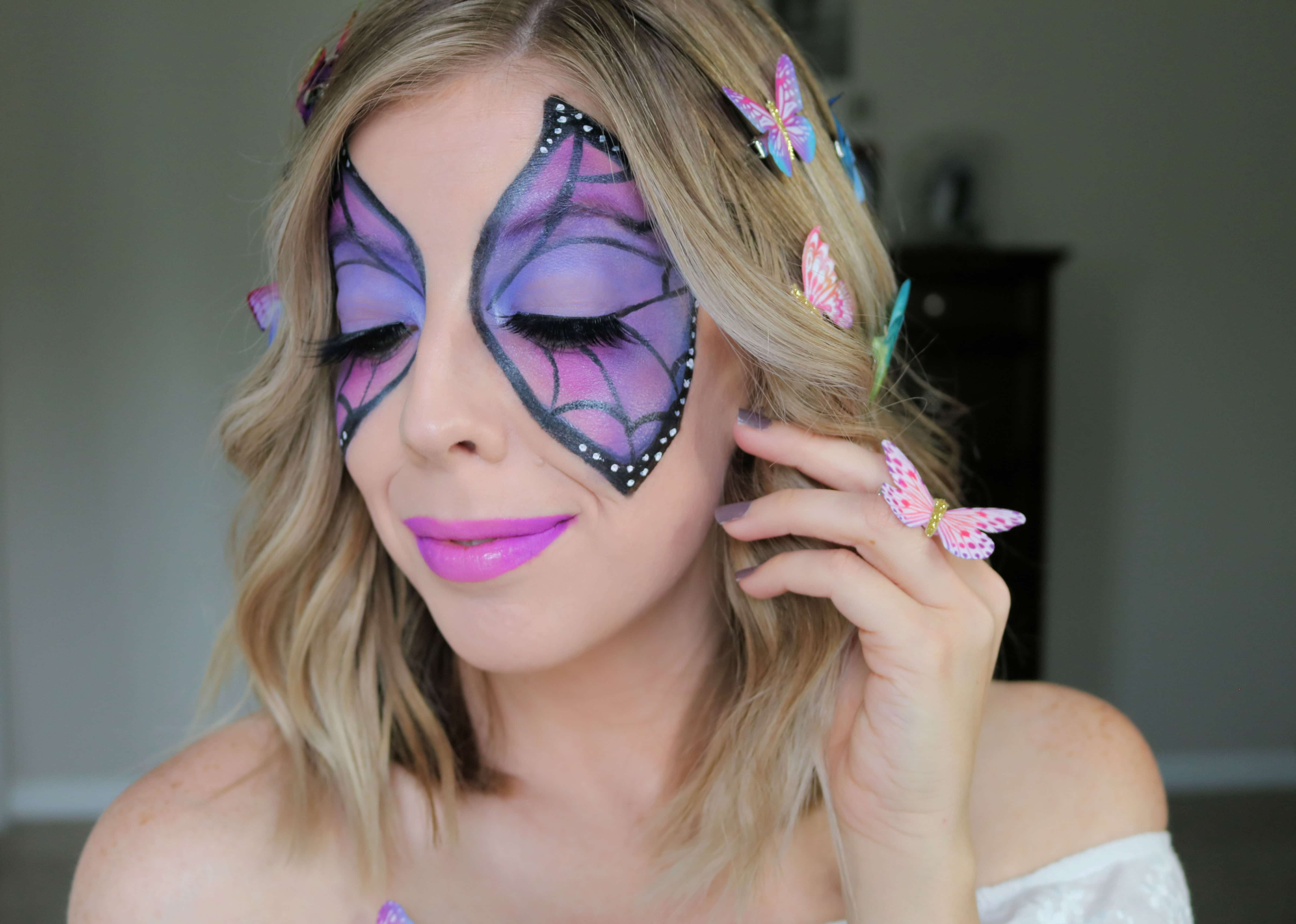 This butterfly makeup look for Halloween is so colorful and fun and perfect if you're looking for a girly halloween costume idea! Get the look with my easy halloween makeup tutorial! #butterflymakeup #halloweenmakeup #halloweentutorial #prettyhalloween