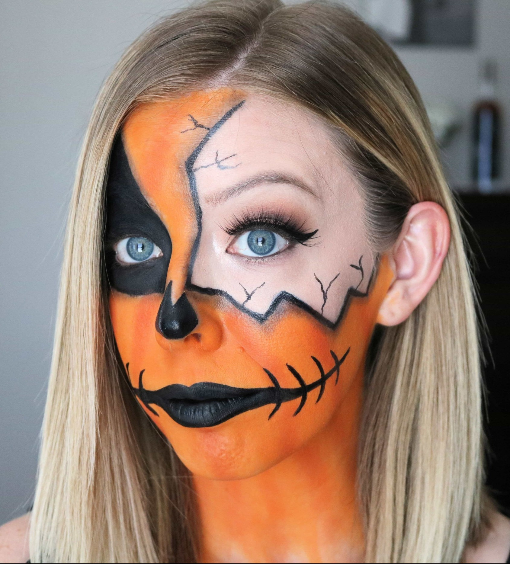 Want a spooky and fun Halloween makeup look this year? Check out my Easy Cracked Pumpkin Makeup Halloween video tutorial! This DIY pumpkin half face makeup is super easy to create and both cute and creepy! #pumpkinmakeup #halloweenmakeup #halloweenmakeuptutorial #halloween