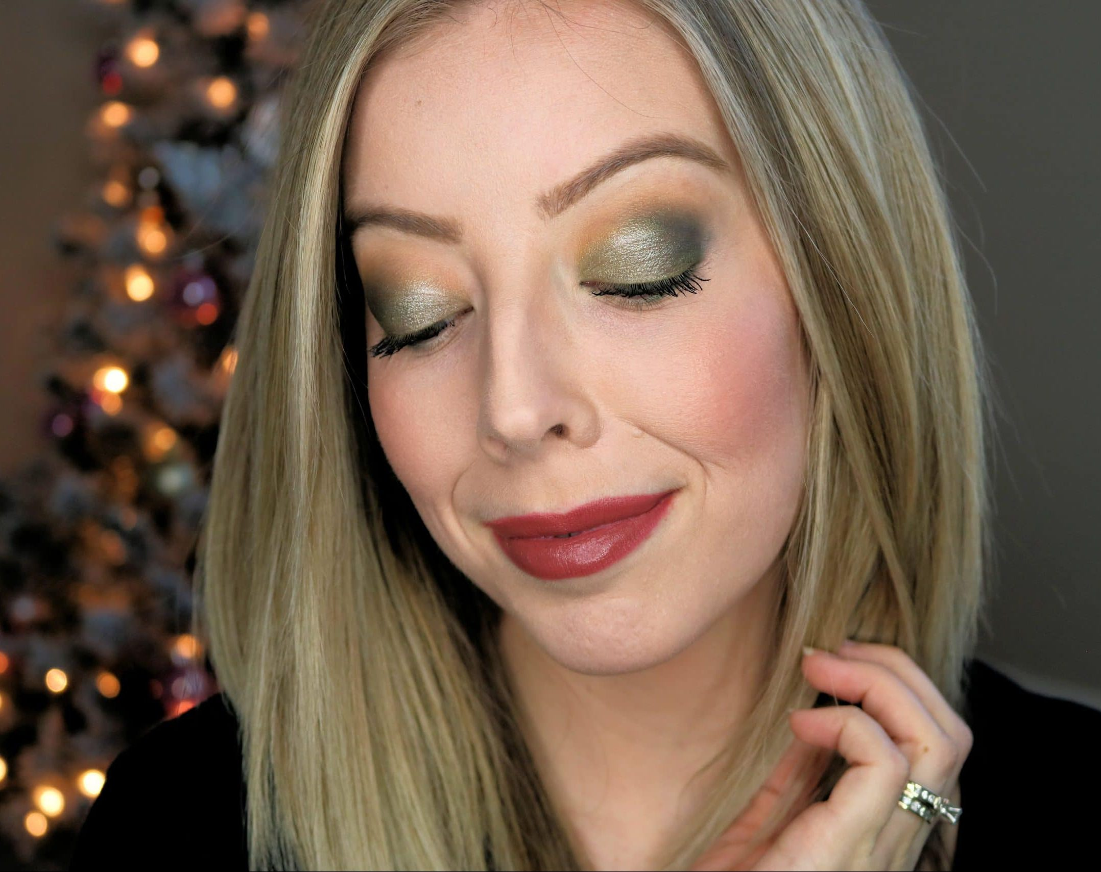 This easy holiday makeup look features a beautiful green eyeshadow with touches of gold shimmer and is perfect for wearing to Christmas and holiday parties. Check out all the makeup products used in my post! #holidaymakeup #makeup #makeuptutorial #drugstoremakeup #greeneyeshadow