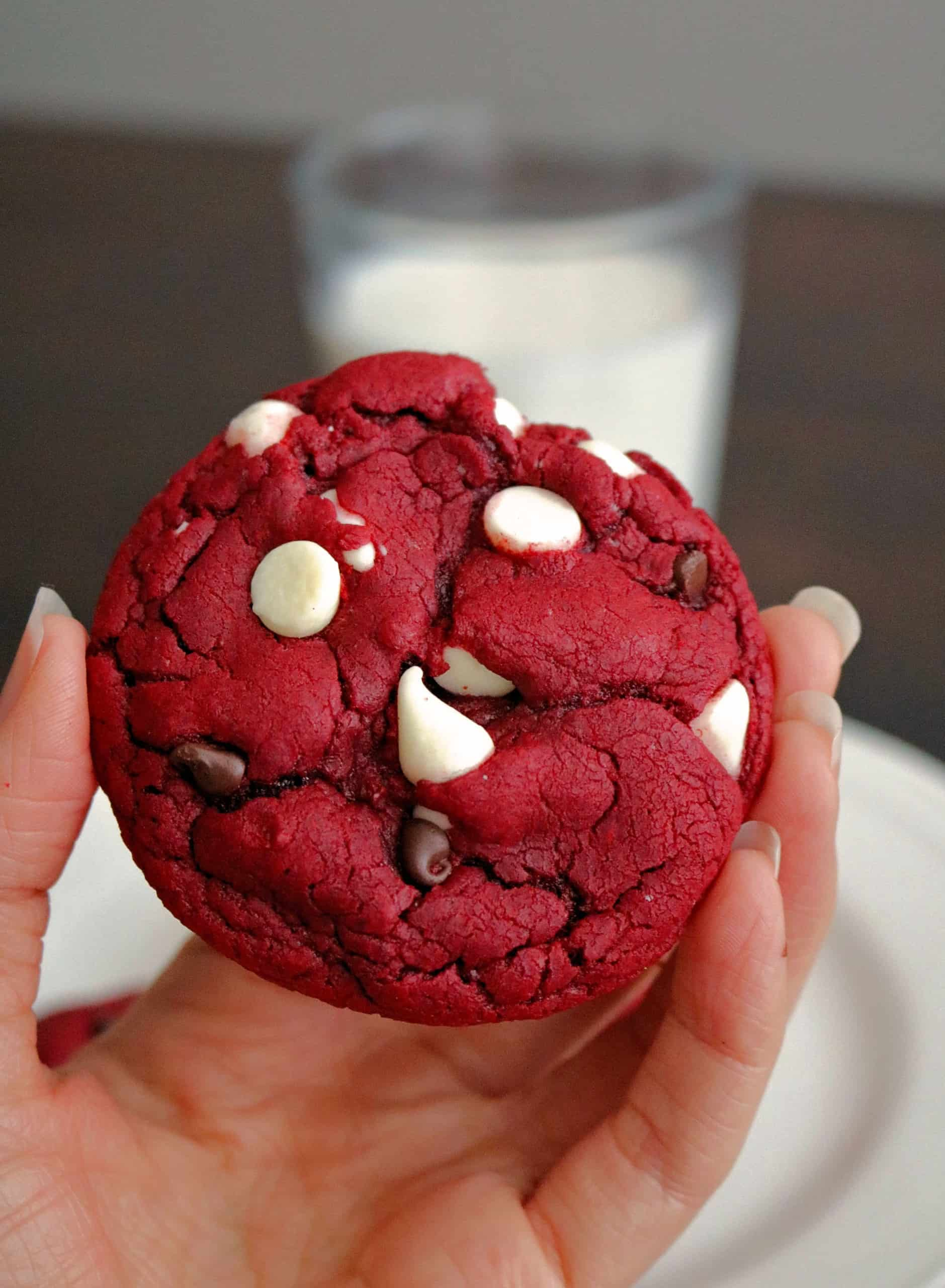 With just 5 ingredients, these soft, chewy, and delicious Red Velvet Cake Mix Cookies are so easy to make. These best ever red velvet cookies are made from a boxed cake mix, white chocolate chips, and miniature semi sweet chocolate chips, and are perfect for Christmas, Valentine's Day, or anytime you're craving red velvet cake! #redvelvetcookies #cookies #cakemixcookies #christmascookies #valentinescookies #redvelvet