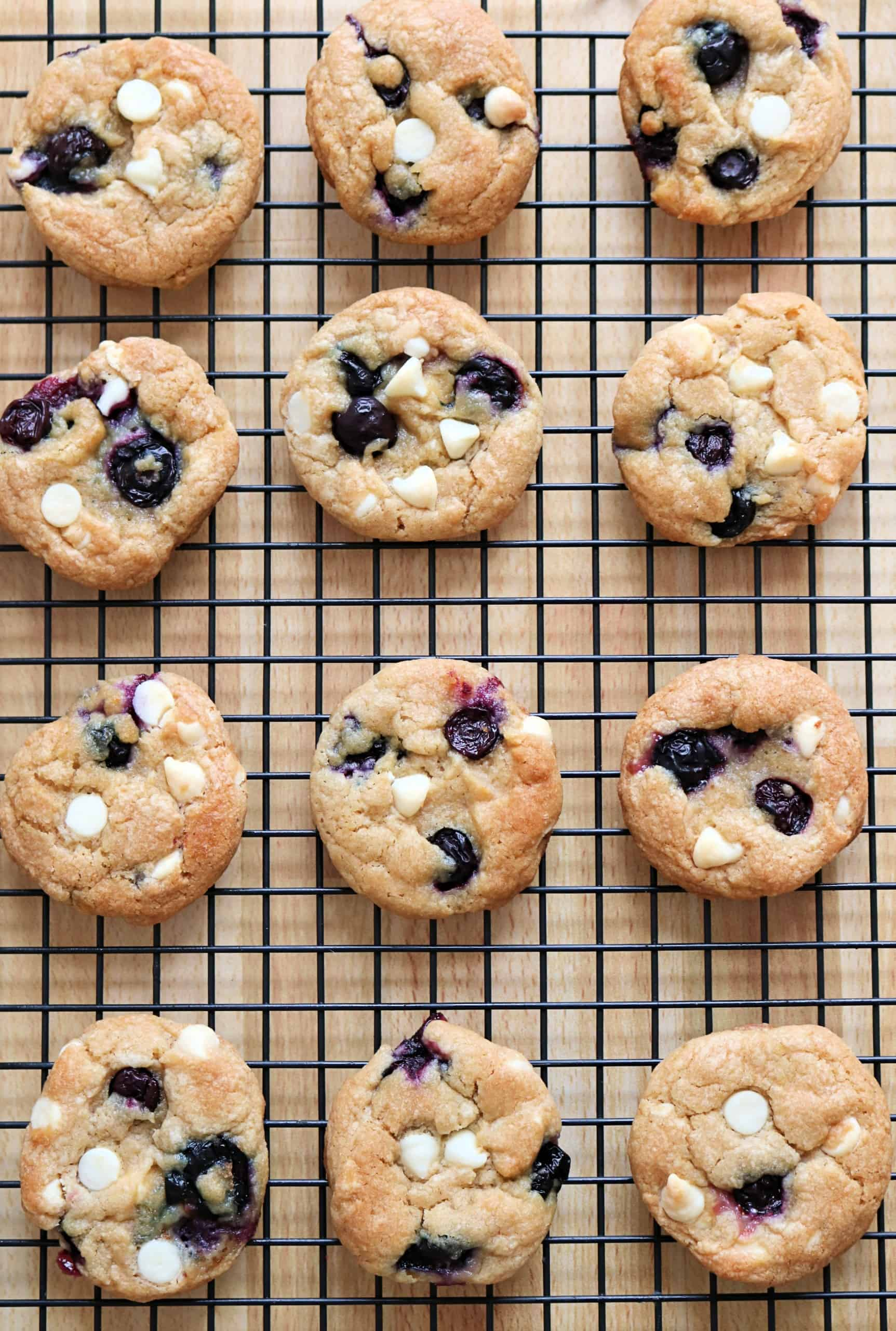 These easy, soft, and delicious Blueberry Cheesecake Cookies are officially the best homemade blueberry cookies ever! Made simple with fresh blueberries, white chocolate chips, cream cheese, brown sugar, and cheesecake pudding mix, they'll quickly become your new favorite cookie. #blueberrycookies #blueberrycheesecakecookies #cheesecakecookies #cookies #puddingmixcookies