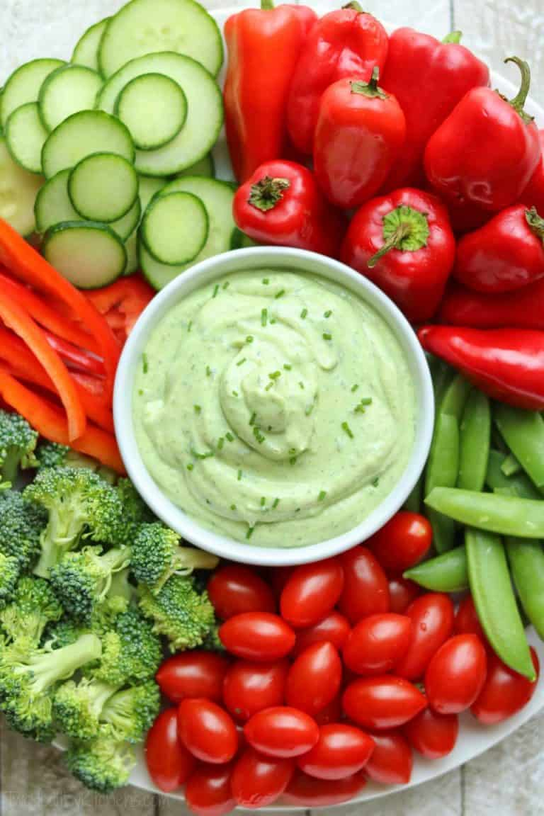 Healthy Avocado Ranch Dip - Check out these 25 Delicious and Easy Healthy Snack Recipes for clean eating and weight loss. This list is full of simple-ingredient, healthy snacks like no bake bars, cookies, chips, healthy dips, granola, veggies, smoothie bowls, and more! #snacks #healthysnacks #cleaneating #weightloss #healthsnackideas #healthyrecipes