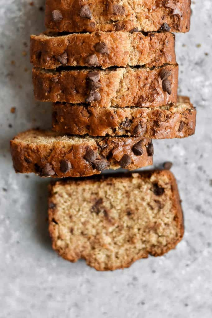 Best Chocolate Chip Banana Bread - Check out these 25 Delicious and Easy Healthy Snack Recipes for clean eating and weight loss. This list is full of simple-ingredient, healthy snacks like no bake bars, cookies, chips, healthy dips, granola, veggies, smoothie bowls, and more! #snacks #healthysnacks #cleaneating #weightloss #healthsnackideas #healthyrecipes