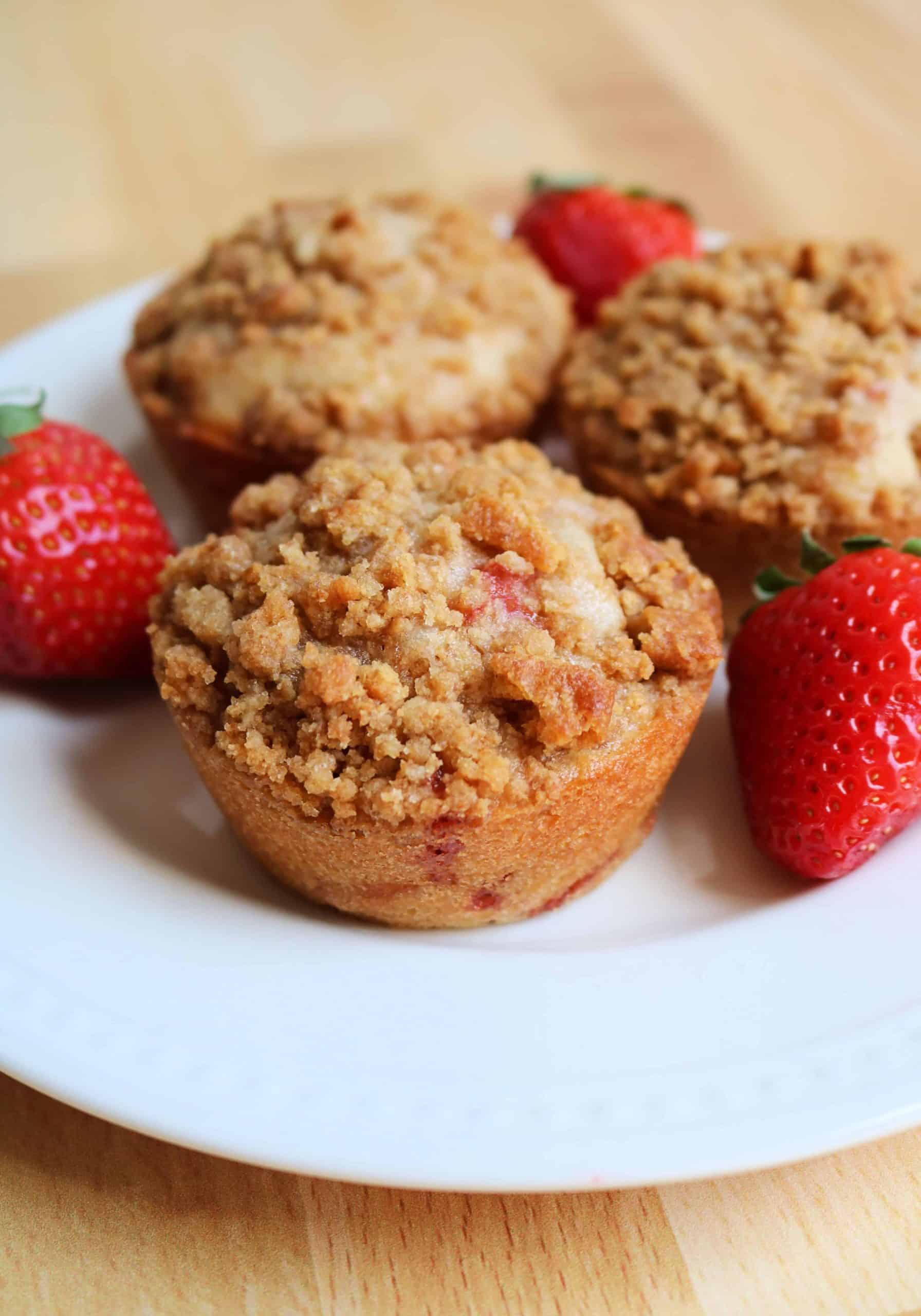 Try my easy and delicious Homemade Strawberry Cheesecake Muffins for breakfast this weekend! These strawberry muffins are soft, delicious, and feature diced fresh strawberries, a surprise lemon cream cheese filling, and a graham cracker and brown sugar streusel topping. #strawberrymuffins #strawberrycheesecakemuffins #breakfastrecipe #muffins