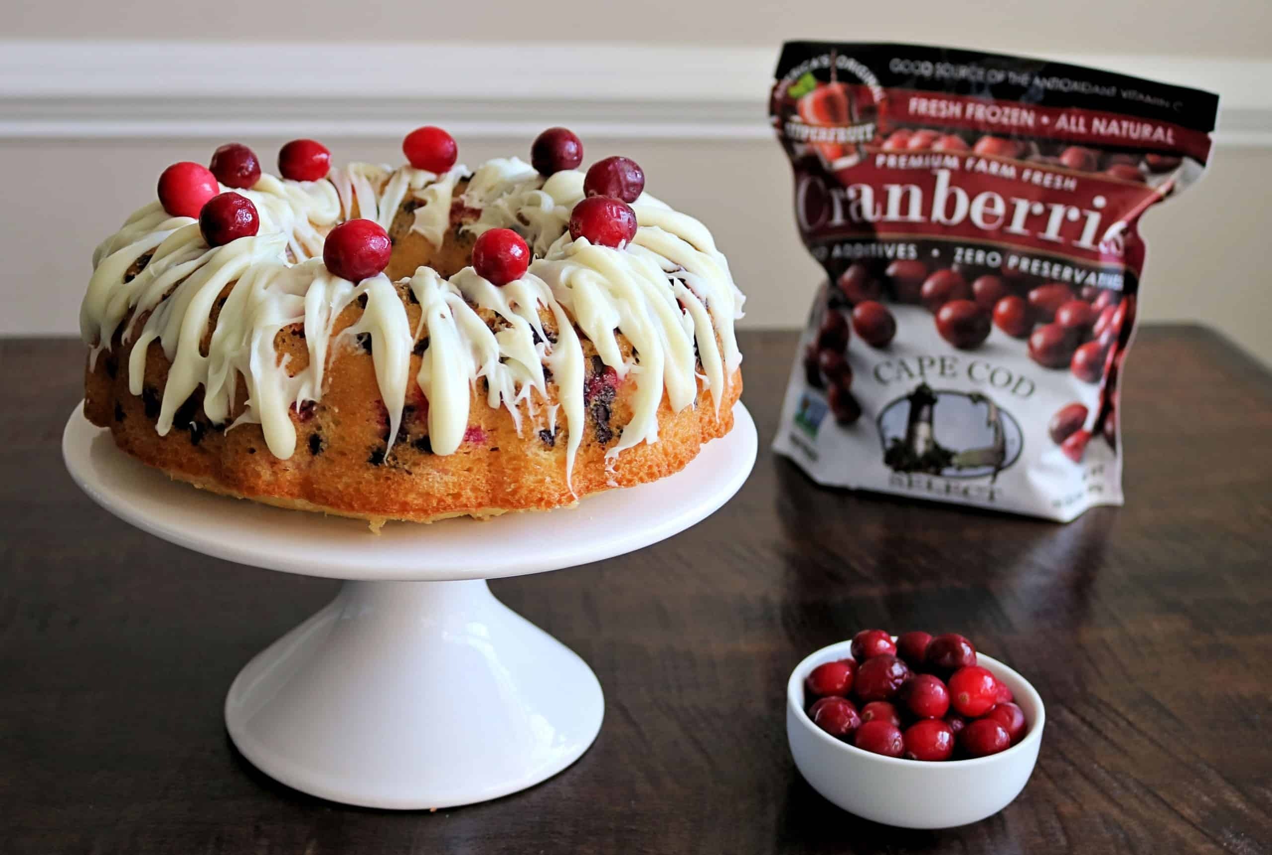 This Double Chocolate Cranberry Bundt Cake is beautiful, easy to make, and the best cranberry cake you'll ever eat! It's made with a french vanilla cake mix, frozen cranberries, semi-sweet chocolate chips, and drizzled with a simple white chocolate glaze for an incredible cake perfect for the holidays or anytime you're craving cranberries! #cranberrycake #cake #FrozenCranberries #YearOfTheCranberry #CapeCodSelect #SelectTheBest @CapeCodSelect