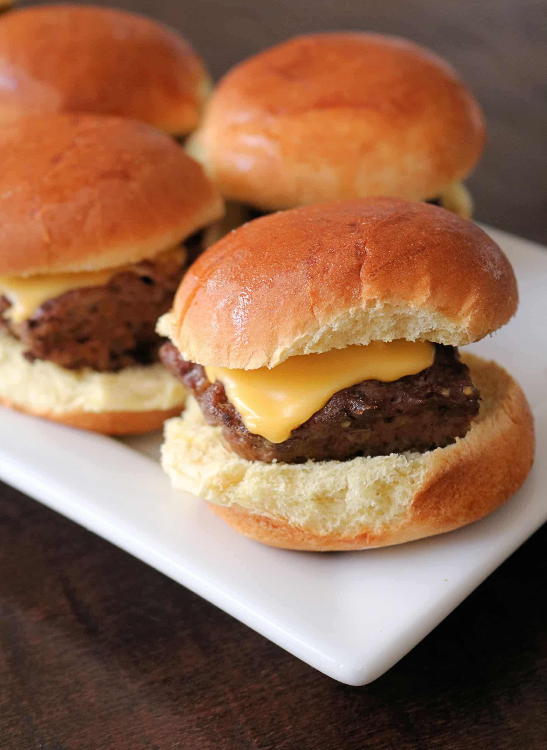 Grab some hamburger meat, dinner rolls, and cheese, and make these Delicious and Easy Cheeseburger Sliders for your next family dinner! They're juicy, flavorful, and oven baked on a sheet pan for quick and easy cheeseburgers for a crowd or party! #cheeseburgersliders #sliders #cheeseburgers #easydinner