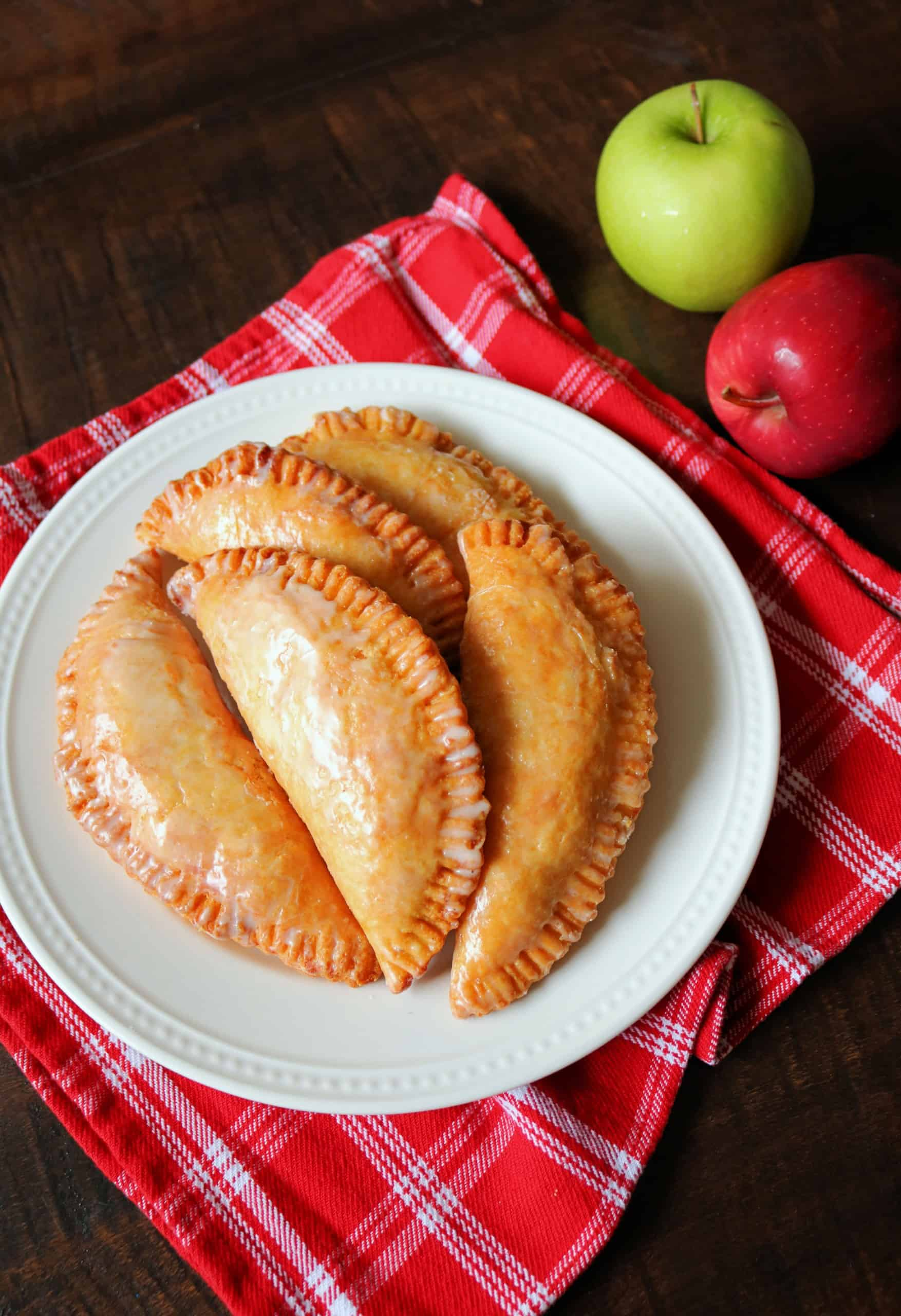 There's nothing better than Southern Fried Apple Pies in the Fall! Check out my Best Fried Apple Pies Recipe that's made completely homemade from scratch! These old fashioned Amish-Style Fried Apple Hand Pies are so easy and delicious with a tender, flaky, and buttery pie crust, a cinnamon sugar apple pie filling, and a sweet powdered sugar glaze. #friedapplepies #applepie #falldesserts