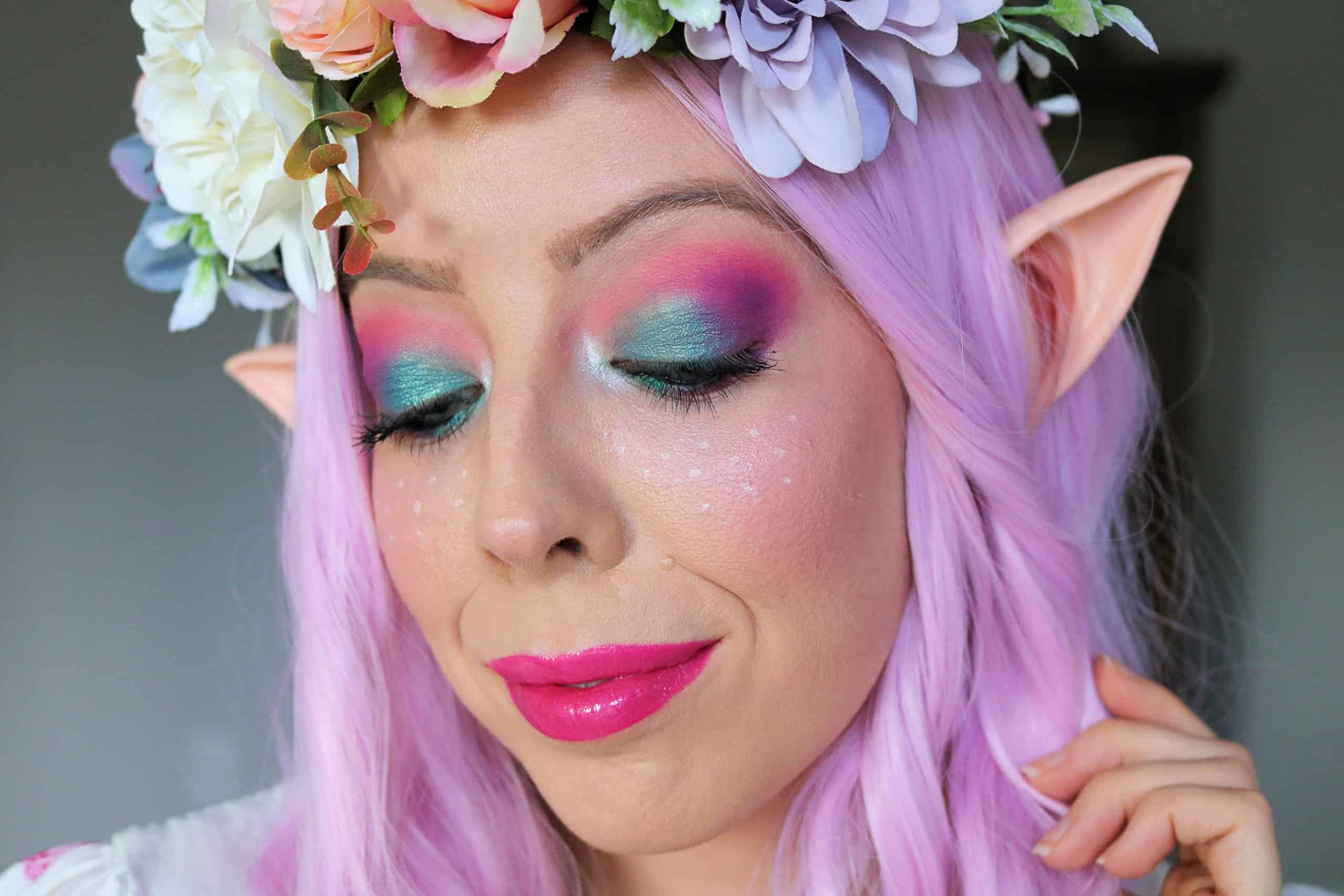 Turn yourself into a beautiful, magical garden fairy this year with my Colorful Fairy Makeup Halloween Tutorial & DIY Fairy Halloween Costume. This Fairy Makeup look is both fun and easy to create and features a bright pink, purple, and turquoise eyeshadow look, cute fairy freckles, and glowing skin. #fairymakeup #fairycostume #halloweenmakeup #makeuptutorial