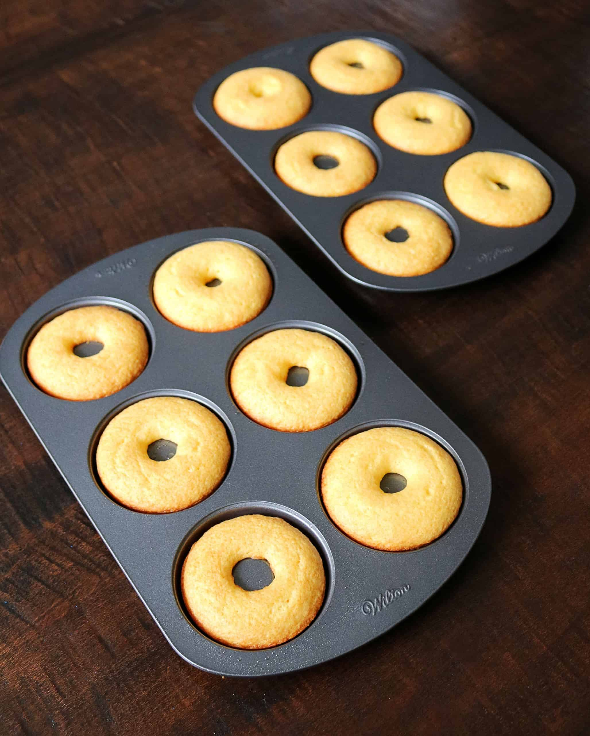 These Easy Cake Mix Donuts are delicious and so simple to make! These yellow cake mix donuts are made with a boxed cake mix and baked instead of fried. Top them off with one of my delicious glazes including vanilla, chocolate, or maple, and decorate with fun sprinkles. Kids and adults will love them for breakfast or dessert! #donuts #cakemixdonuts #cakemix #dessert #breakfast