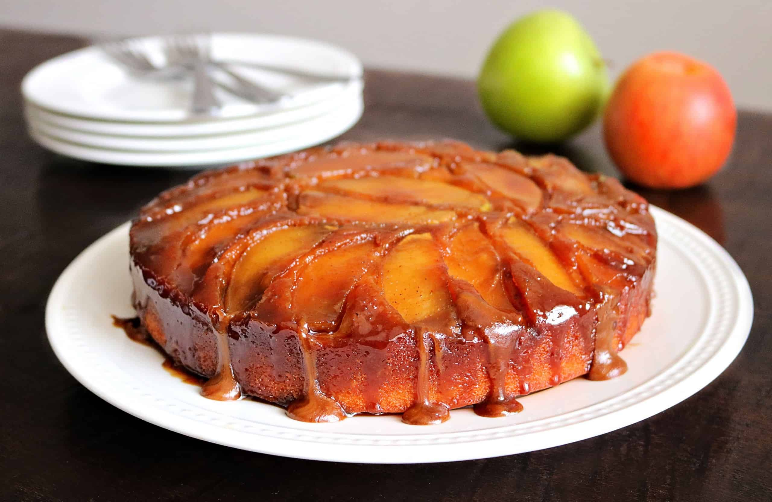 Get my Easy Caramel Apple Upside Down Cake recipe for a beautiful and delicious Fall cake everyone will love! This is the best caramel apple upside down cake you'll ever eat and it features a homemade vanilla cake, topped with a delicious caramel sauce and fresh sliced apples, and baked upside down to perfection. #upsidedowncake #fallcake #applecake #caramelapplecake