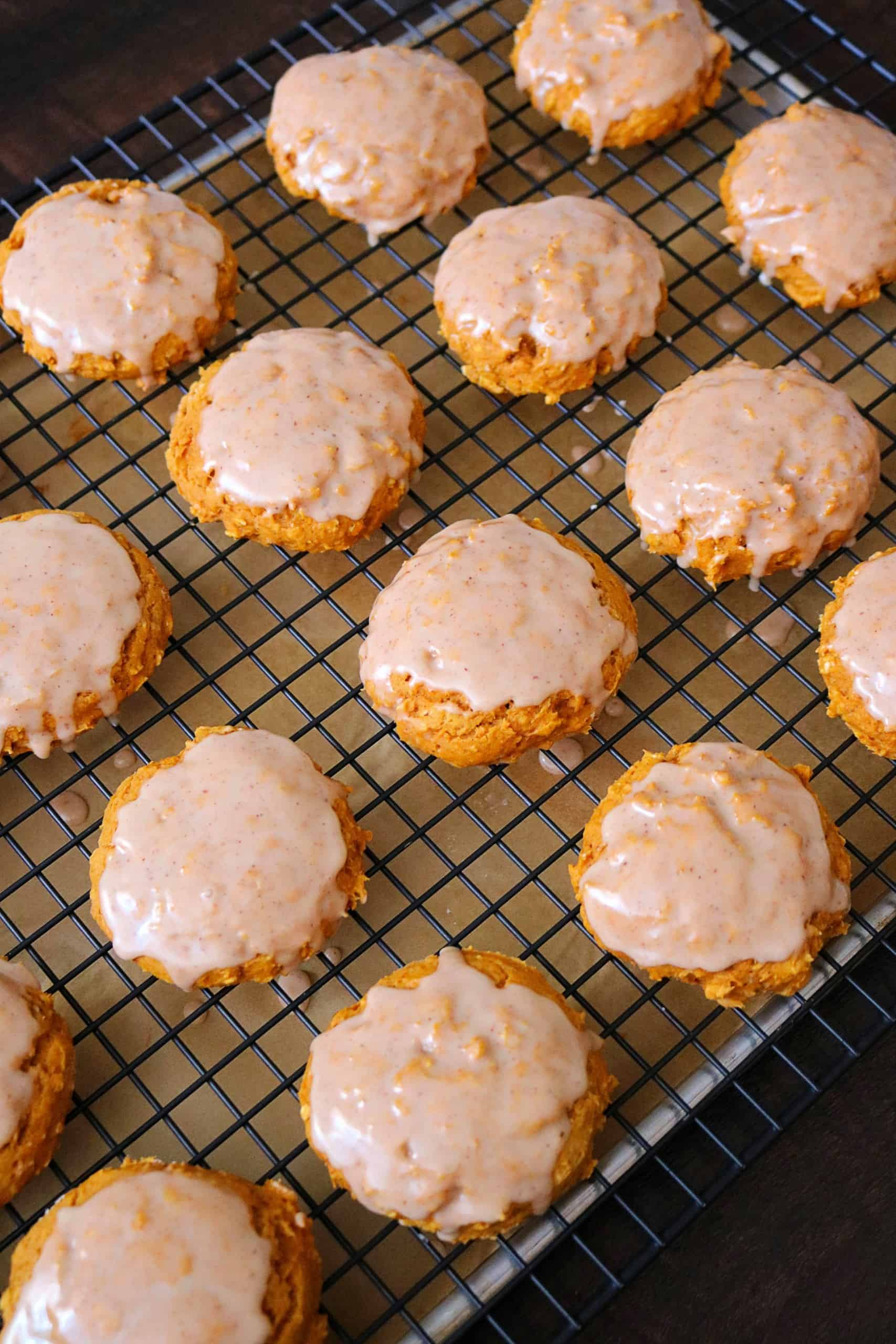 Get the recipe for these Easy Cake Mix Pumpkin Spice Cookies with a Cinnamon Maple Glaze. These pumpkin cookies are soft, chewy, and delicious made with a boxed cake mix, pumpkin puree, quick oats, and pumpkin pie spice. #pumpkincookies #pumpkindessert #thanksgivingdessert #cookies