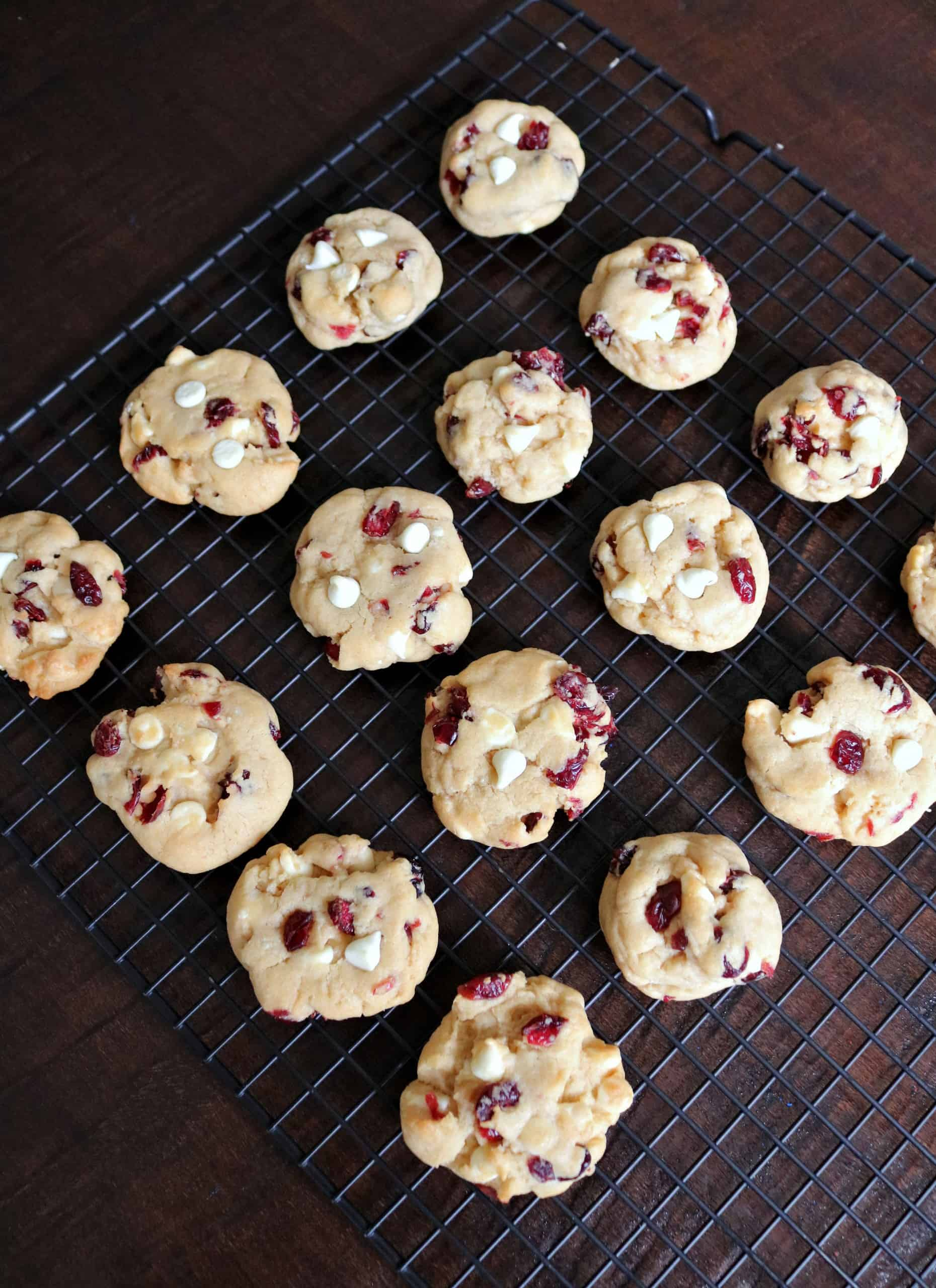 These Easy White Chocolate Cranberry Cookies are great for baking for Thanksgiving, Christmas, or anytime! They're soft, chewy, and loaded with dried cranberries and white chocolate chips for an unbelievably delicious cookie. #cranberrycookies #whitechocolatecookies #cookierecipe