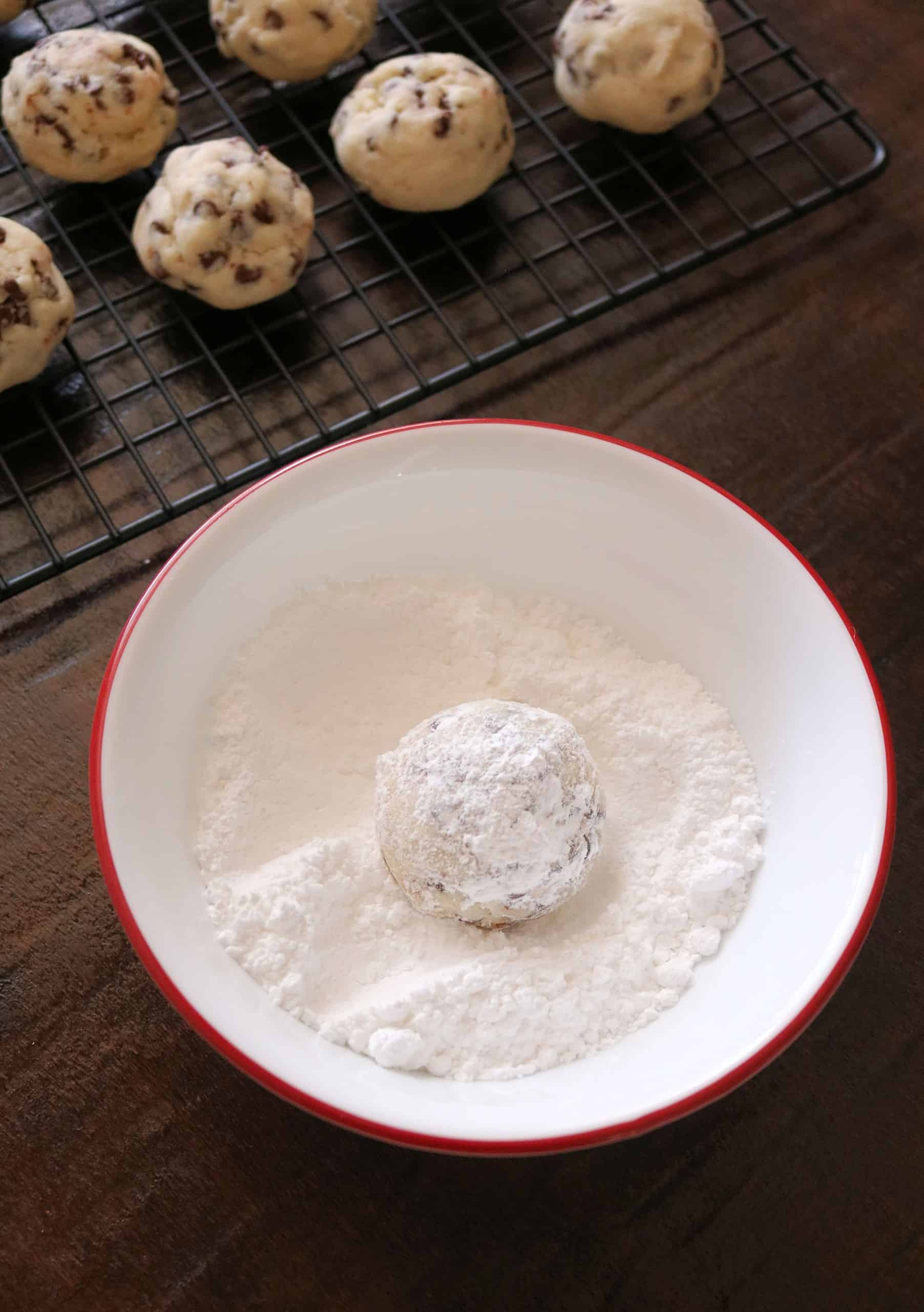 Try my Best Chocolate Chip Snowball Cookies recipe for Christmas! These Chocolate Chip Snowball Cookies are sweet, delicious, buttery cookies rolled in powdered sugar and melt in your mouth! They're nut-free, egg-free, and so easy to make. #snowballcookies #christmascookies #cookierecipe