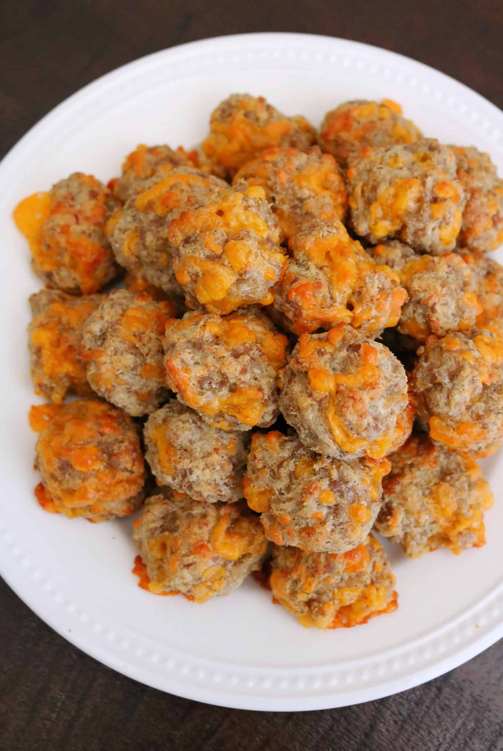 Forget boring sausage balls and try my Best Cream Cheese Sausage Balls Recipe for the best sausage balls ever! These easy sausage and cream cheese balls are made with two ground sausages, bisquick, flavorful spices, cream cheese, and cheddar cheese. So delicious, cheesy, and the perfect easy appetizer, party food, or finger food! #sausageballs #creamcheesesausageballs #appetizer #fingerfood #easyrecipe