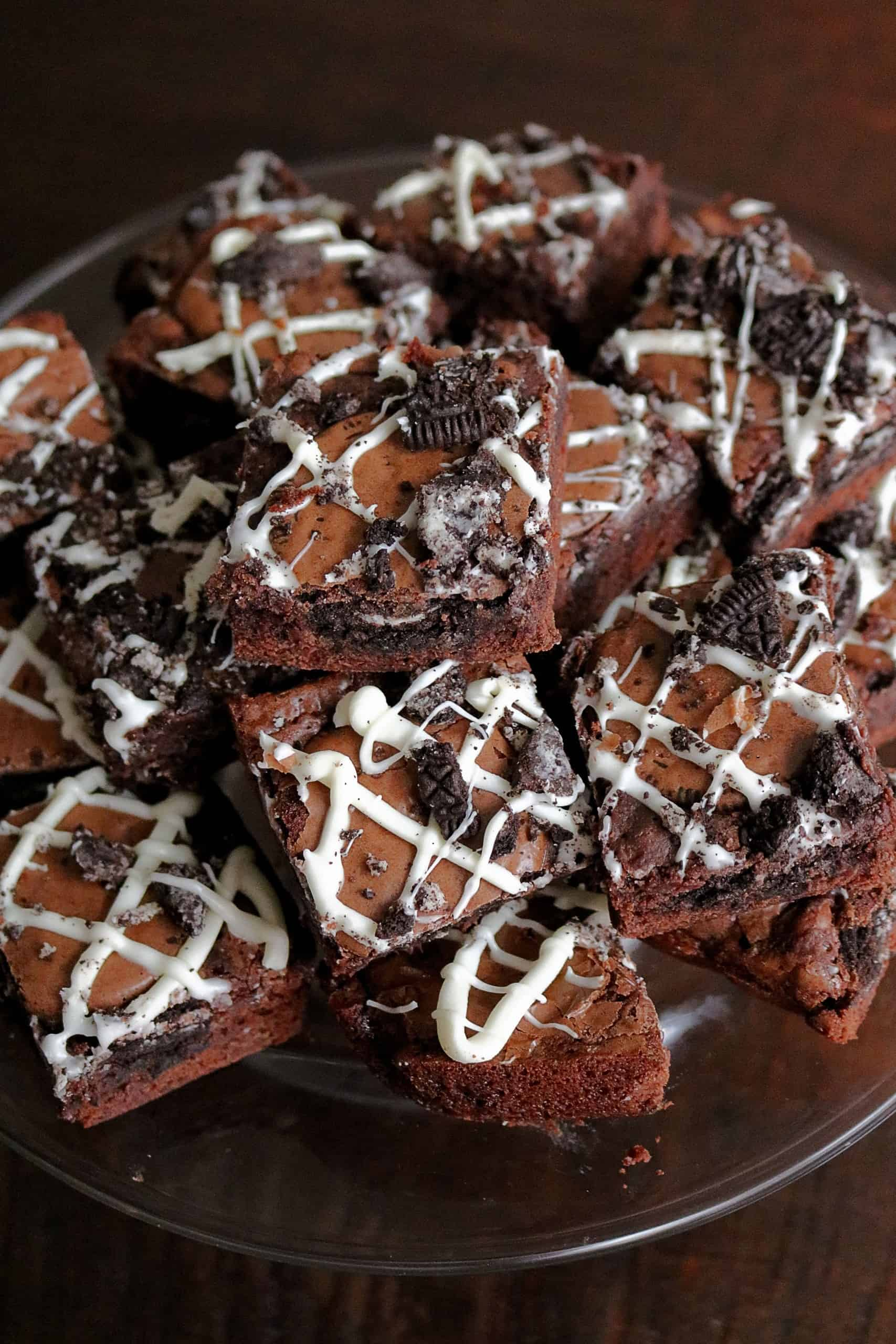If you're a cookies and cream lover, then you'll love these Easy Fudgy Oreo Stuffed Brownies! These Oreo Brownies are made with a simple boxed brownie mix, stuffed and baked with Oreos inside them, and topped with crushed Oreo and a white chocolate drizzle. So easy and delicious! #oreobrownies #brownies #boxedbrownies #brownierecipe #oreo